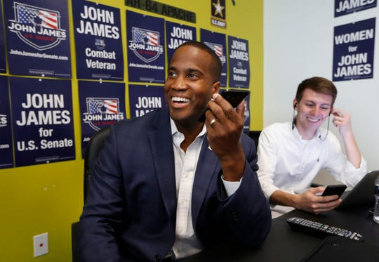 Republican U.S. Senate candidate John James makes a campaign call at his headquarters in Livonia, Aug. 6, 2018.