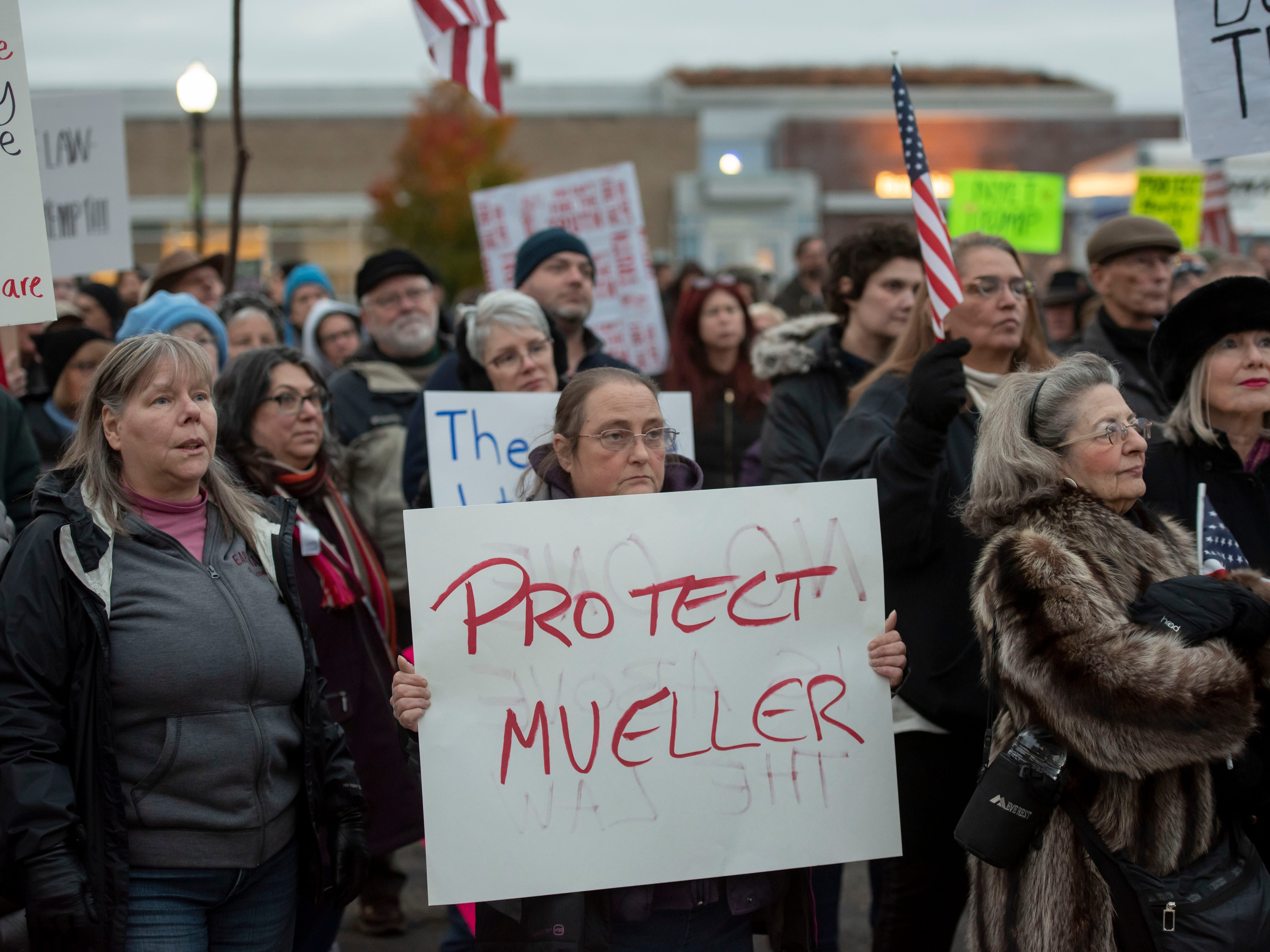 Kelly Kelley of Ferndale holds a sign during a protest at Ferndale City Hall to demand that Special Counsel Robert Mueller's investigation be protected.