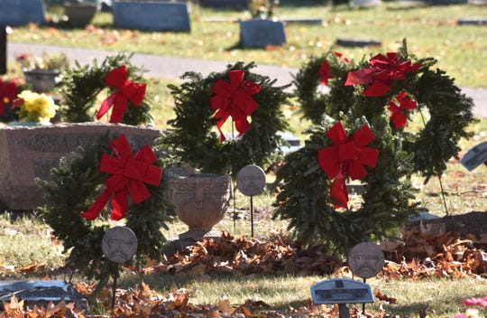 Memorial wreaths rest at some of the 595 graves of MIssaukee County veterans in the Lake City Cemetery. The handmade wreaths were placed to honor all 1,397 Missaukee County veterans who reside in 24 cemeteries in the county.