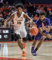 Evansville guard K.J. Riley (33) swats the ball away from Illinois guard Andres Feliz (10) in the first half at State Farm Center in Champaign on Thursday Nov. 8, 2018.