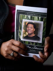 Mariama holds a copy of 21-year-old Amon Johnson's funeral pamphlet. A memorial has been scheduled for 6-8 p.m. Monday, November 12 and a funeral service at 11 a.m. Tuesday, November 13, at the Church of the Harvest in Evansville.