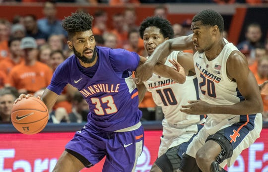Evansville guard K.J. Riley (33) tries to get around Illinois guard Da'Monte Williams (20) at State Farm Center in Champaign on Thursday Nov. 8, 2018.
