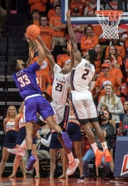 Illinois guard Aaron Jordan (23) and forward Kipper Nichols (2) go up to defend a shot by Evansville guard K.J. Riley (33) in the second half at State Farm Center in Champaign on Thursday Nov. 8, 2018.