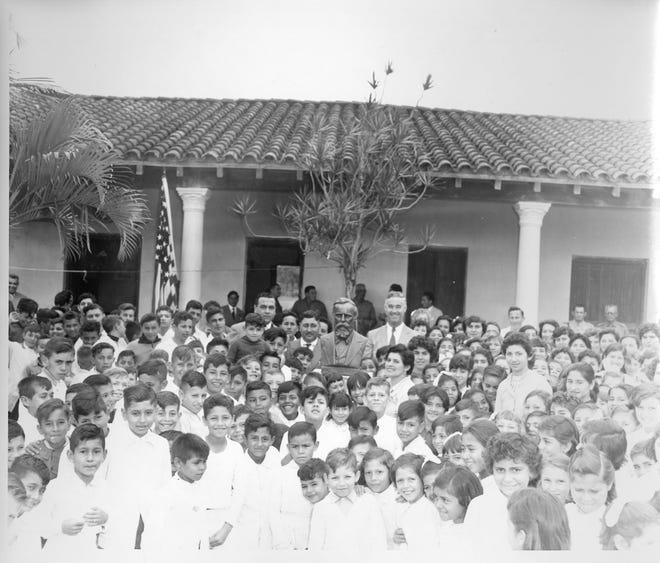 School children in Villa Hayes, Paraguay, stand with a bust of Rutherford B. Hayes. Hayes is a national hero in Paraguay for settling a land dispute in the nation's favor in 1878.