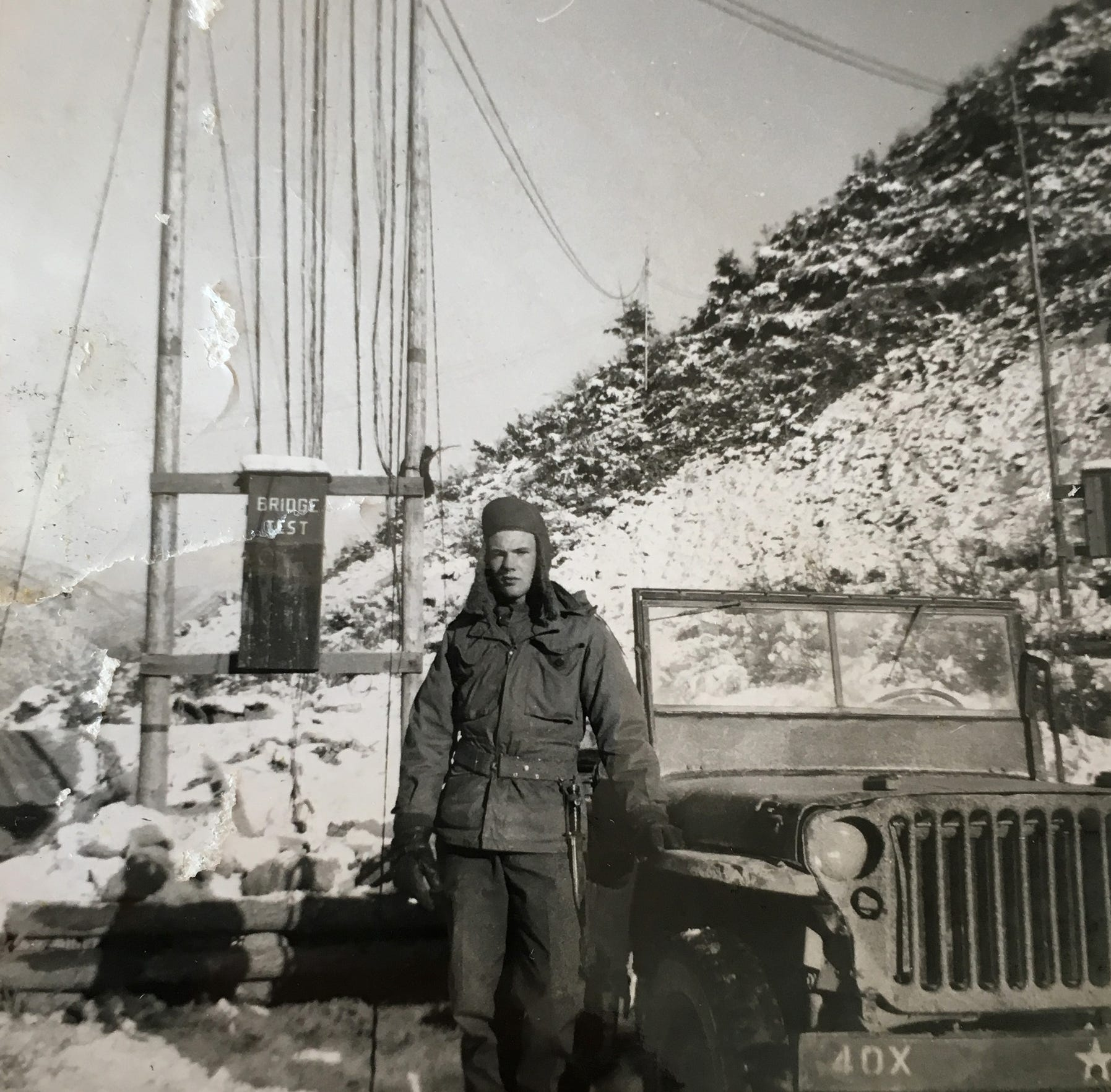 """Edward Foose served as a pole lineman, stringing phone and teletype lines in full view of enemy soldiers who shot at him from across the 38th Parallel. """"""""They had fun using us as targets,"""" Foose said."""