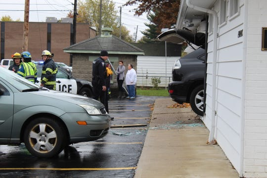 SUV crashes into Croghan Street salon Friday.