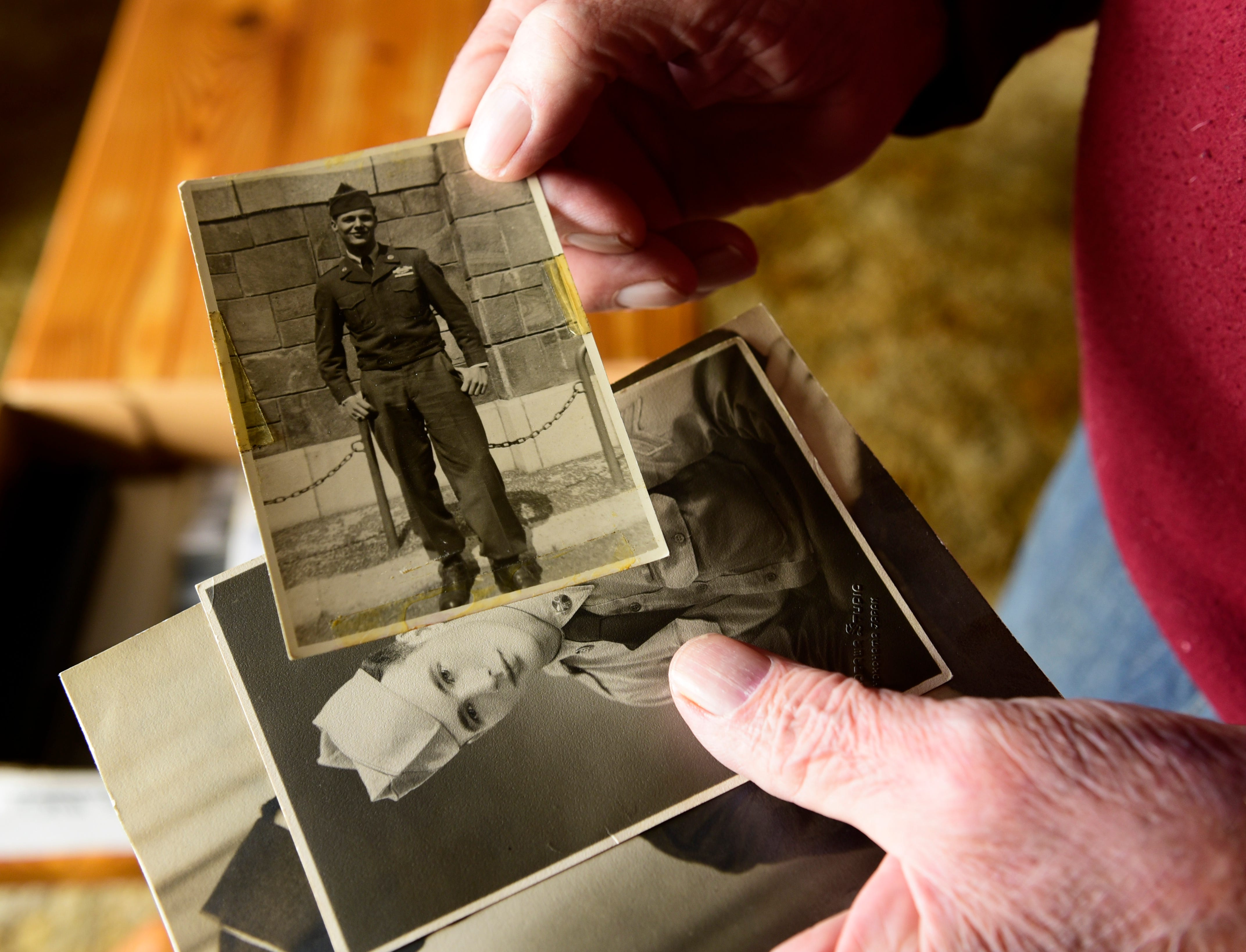 Edward Foose holds a photo of himself as a soldier during the Korean War. During the three years of fighting in Korea, more than 1.5 million Americans were drafted for military
