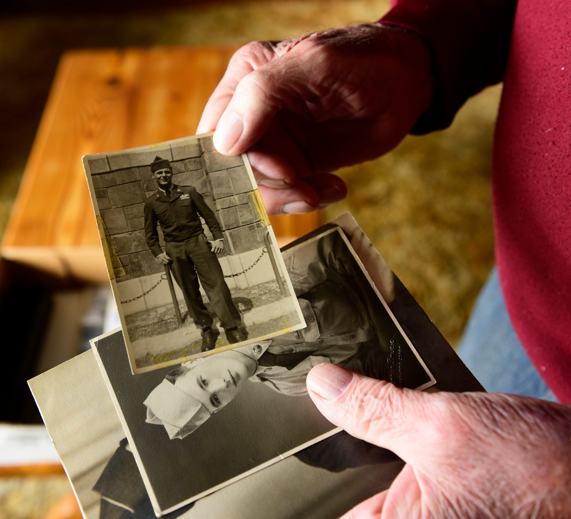 Edward Foose holds a photo of himself as a soldier during the Korean War. During the three years of fighting in Korea, more than 1.5 million Americans were drafted for militaryservice.