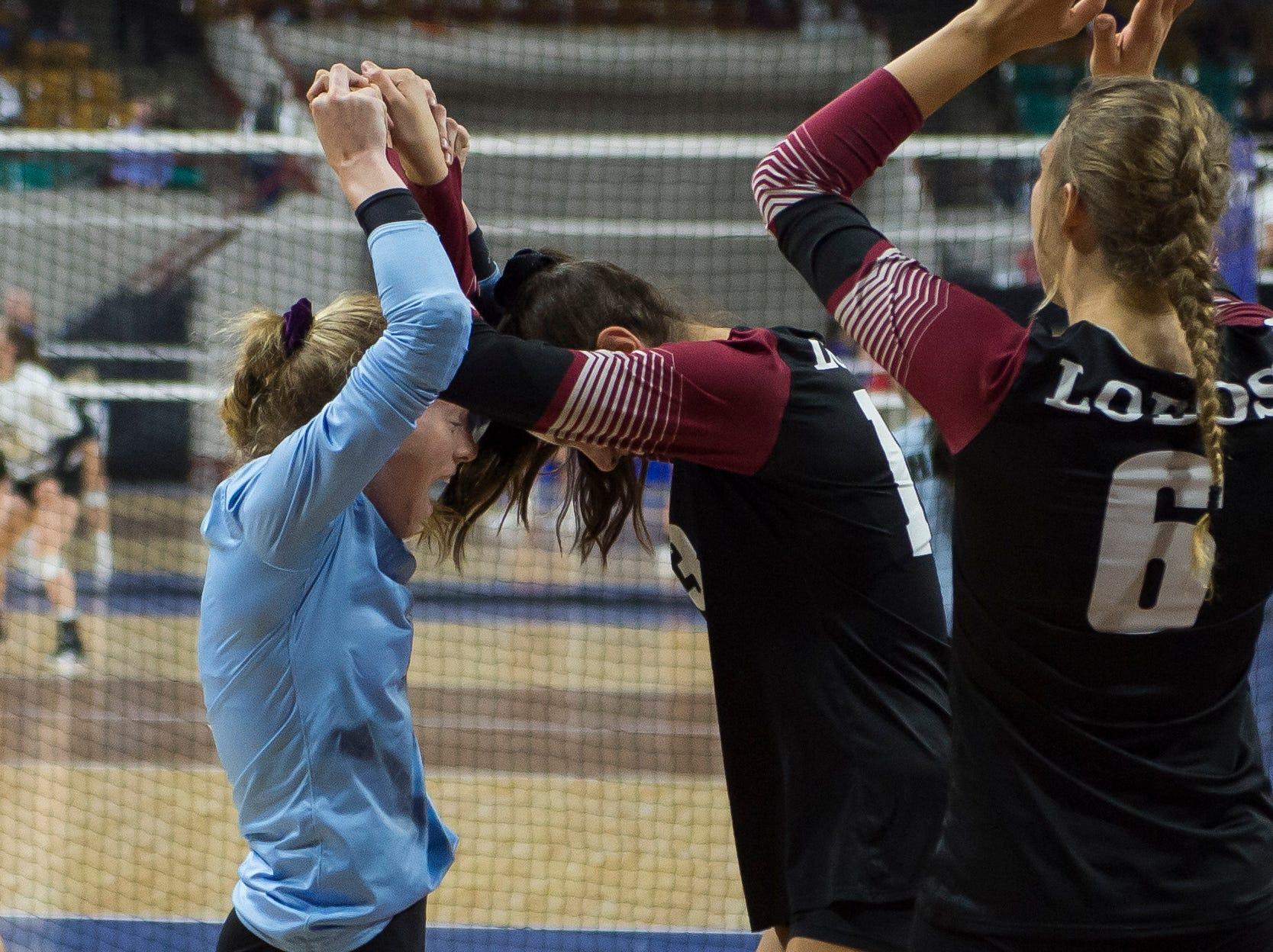 Rocky Mountain High School senior Annika Larson (1) talks to freshman Pryor MacEachran (13) during a first round state game against Eaglecrest on Thursday, Nov. 8, 2018, at the Denver Coliseum in Denver, Colo.
