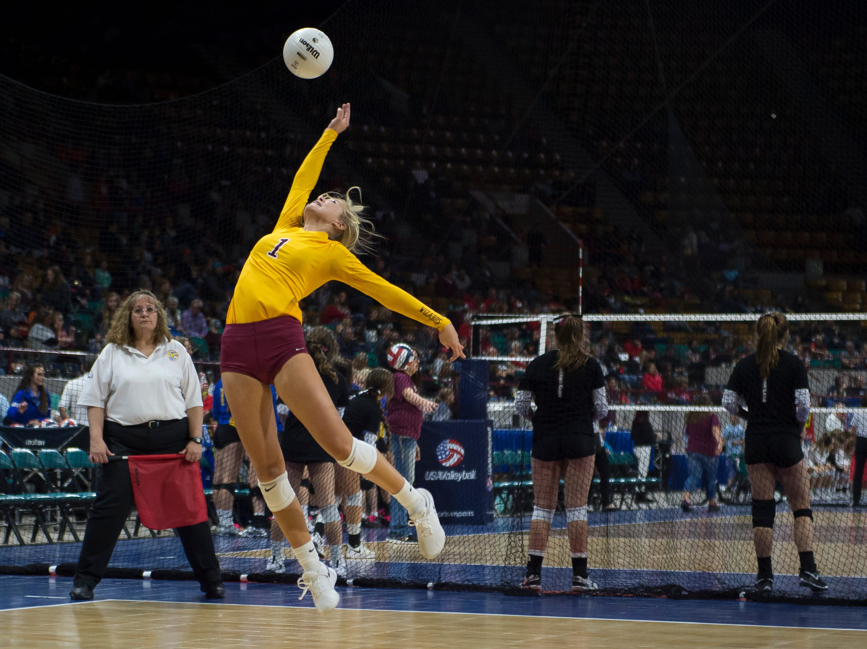 Windsor High School senior Hollie Hoffman (1) can't quite grab volley during a state first round game against Fossil Ridge High School on Thursday, Nov. 8, 2018, at the Denver Coliseum in Denver, Colo.
