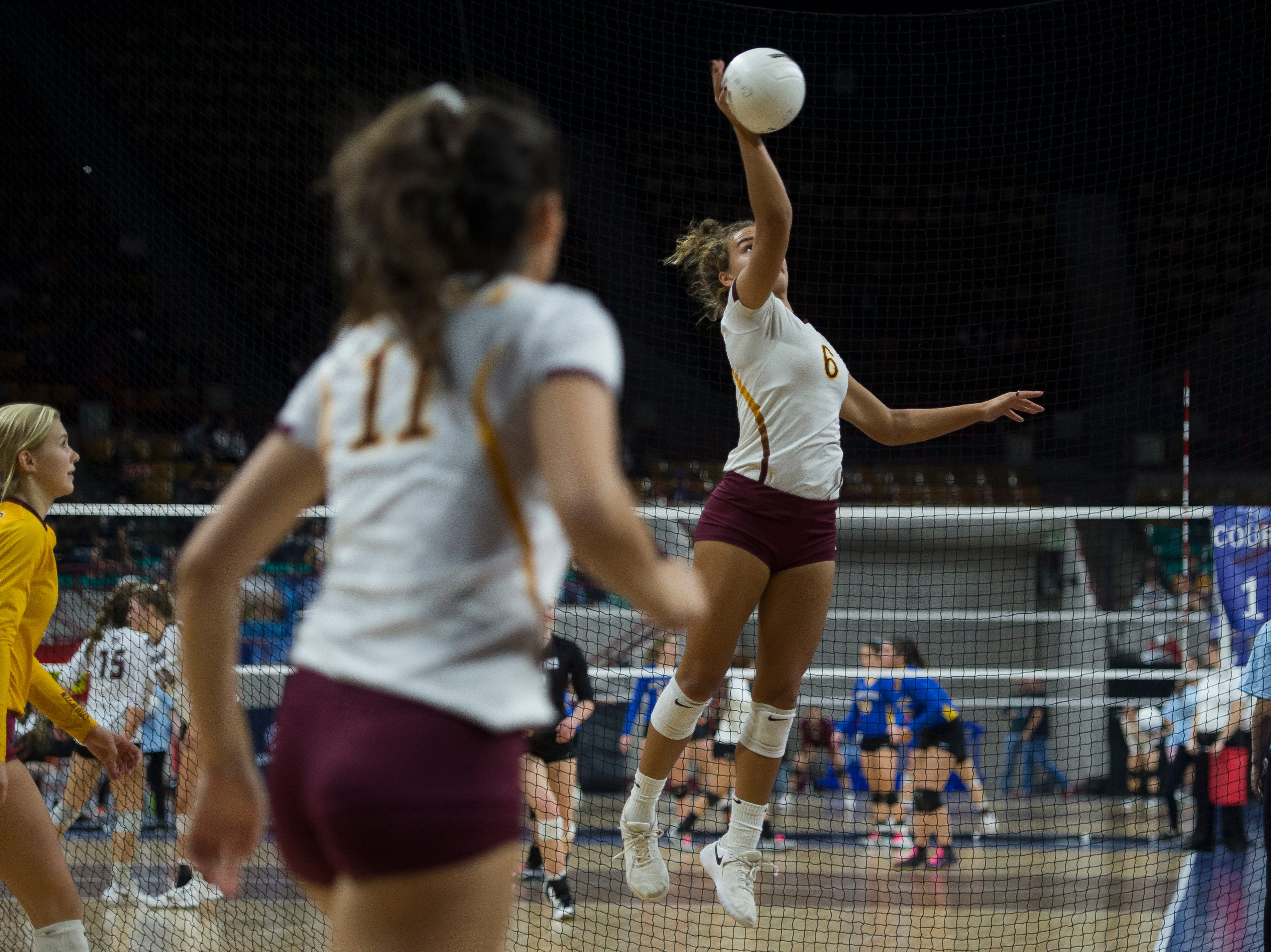 Windsor High School senior Ally Kennis (6) spikes the ball during a state first round game against Fossil Ridge High School on Thursday, Nov. 8, 2018, at the Denver Coliseum in Denver, Colo.