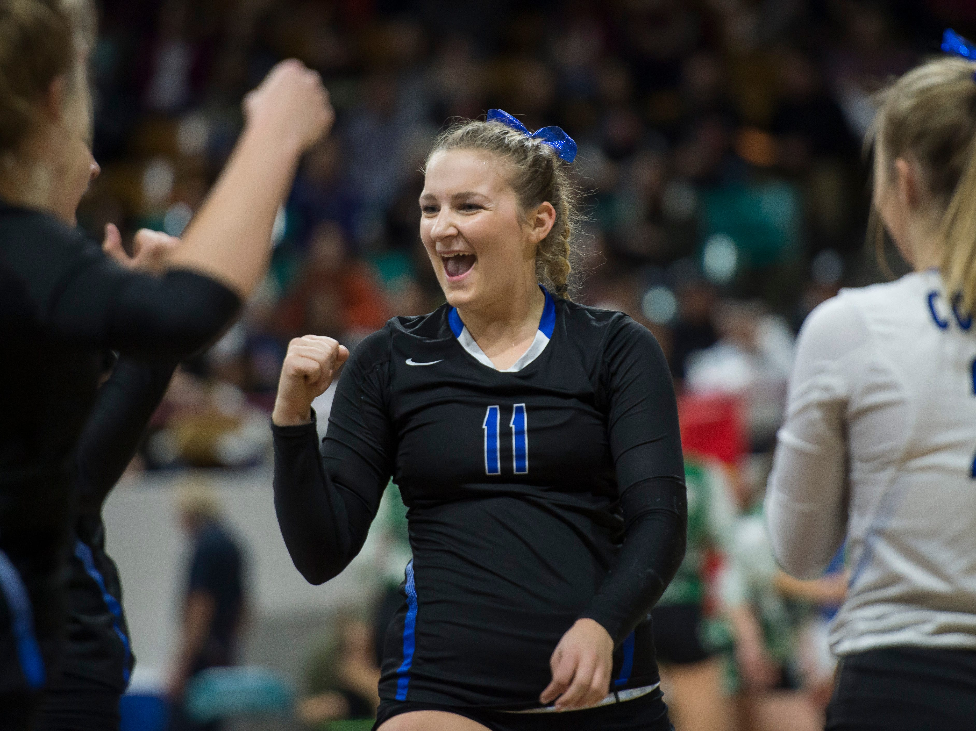 Resurrection Christian senior Bryce Lienemann (11) celebrates a point with teammates during a first round state game against Faith Christian on Thursday, Nov. 8, 2018, at the Denver Coliseum in Denver, Colo.