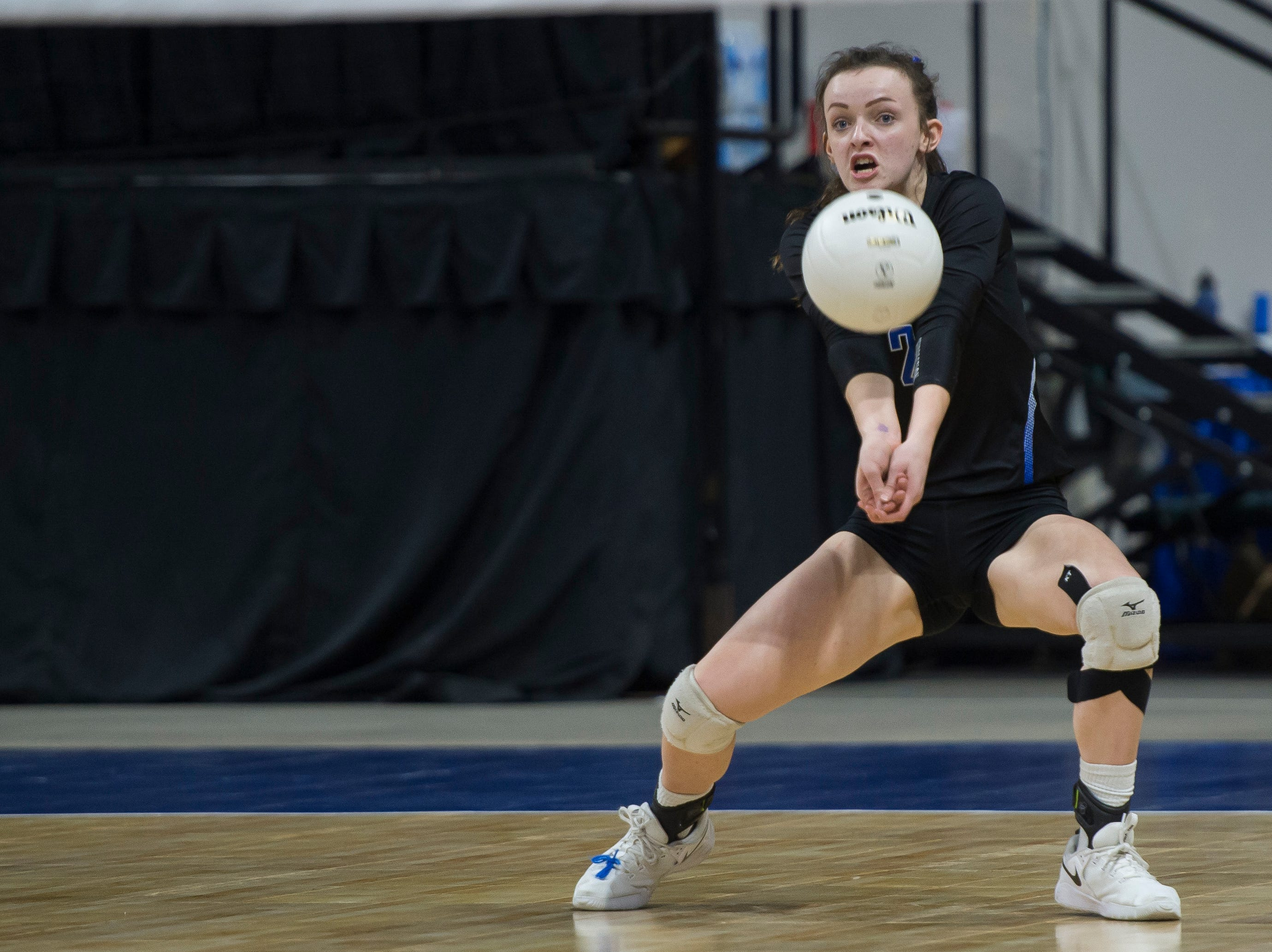 Resurrection Christian freshman Aly Reeser (2) digs a ball during a first round state game against Faith Christian on Thursday, Nov. 8, 2018, at the Denver Coliseum in Denver, Colo.