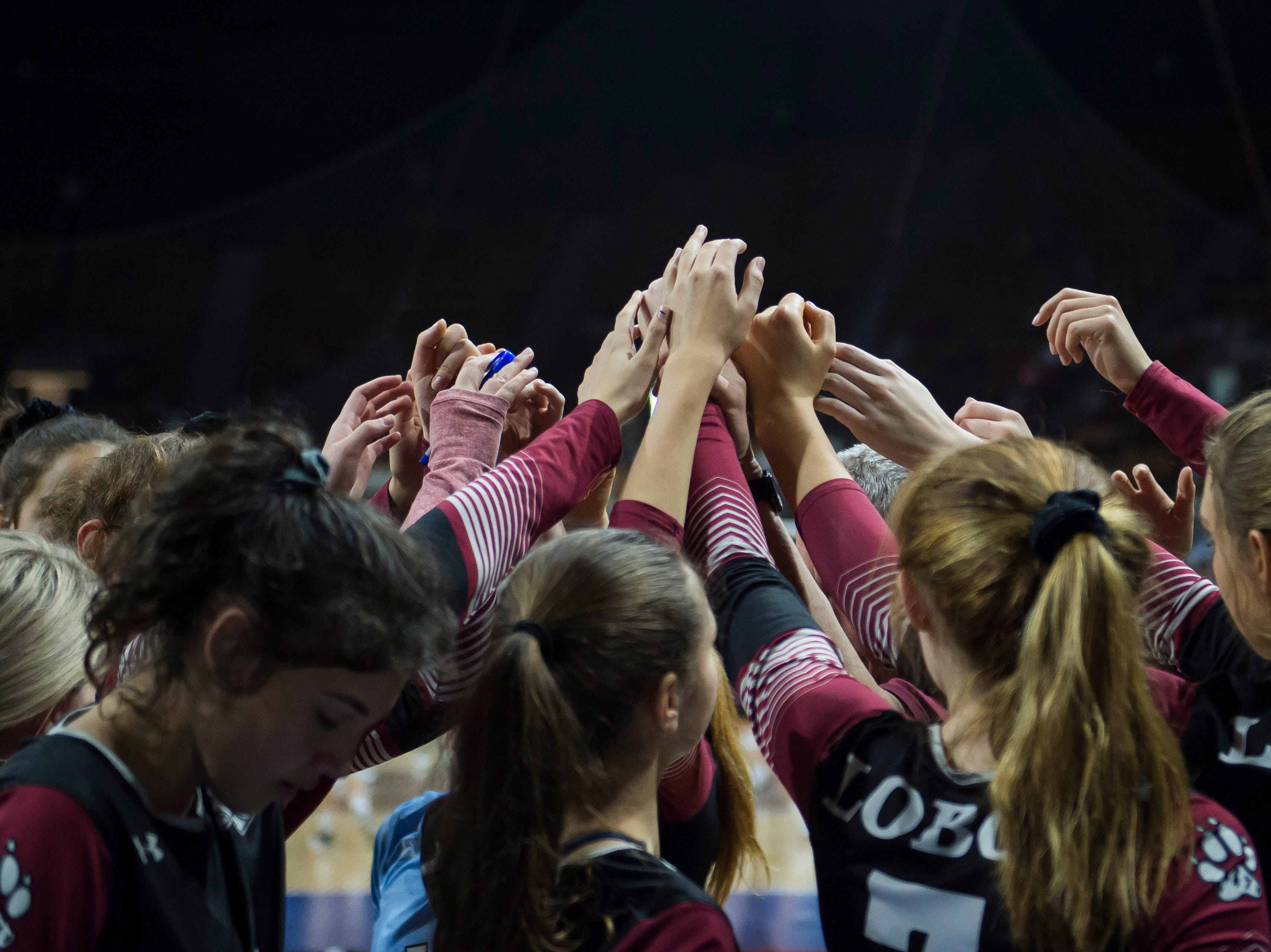 The Rocky Mountain High School volleyball team huddles up during a first round state game against Eaglecrest on Thursday, Nov. 8, 2018, at the Denver Coliseum in Denver, Colo.
