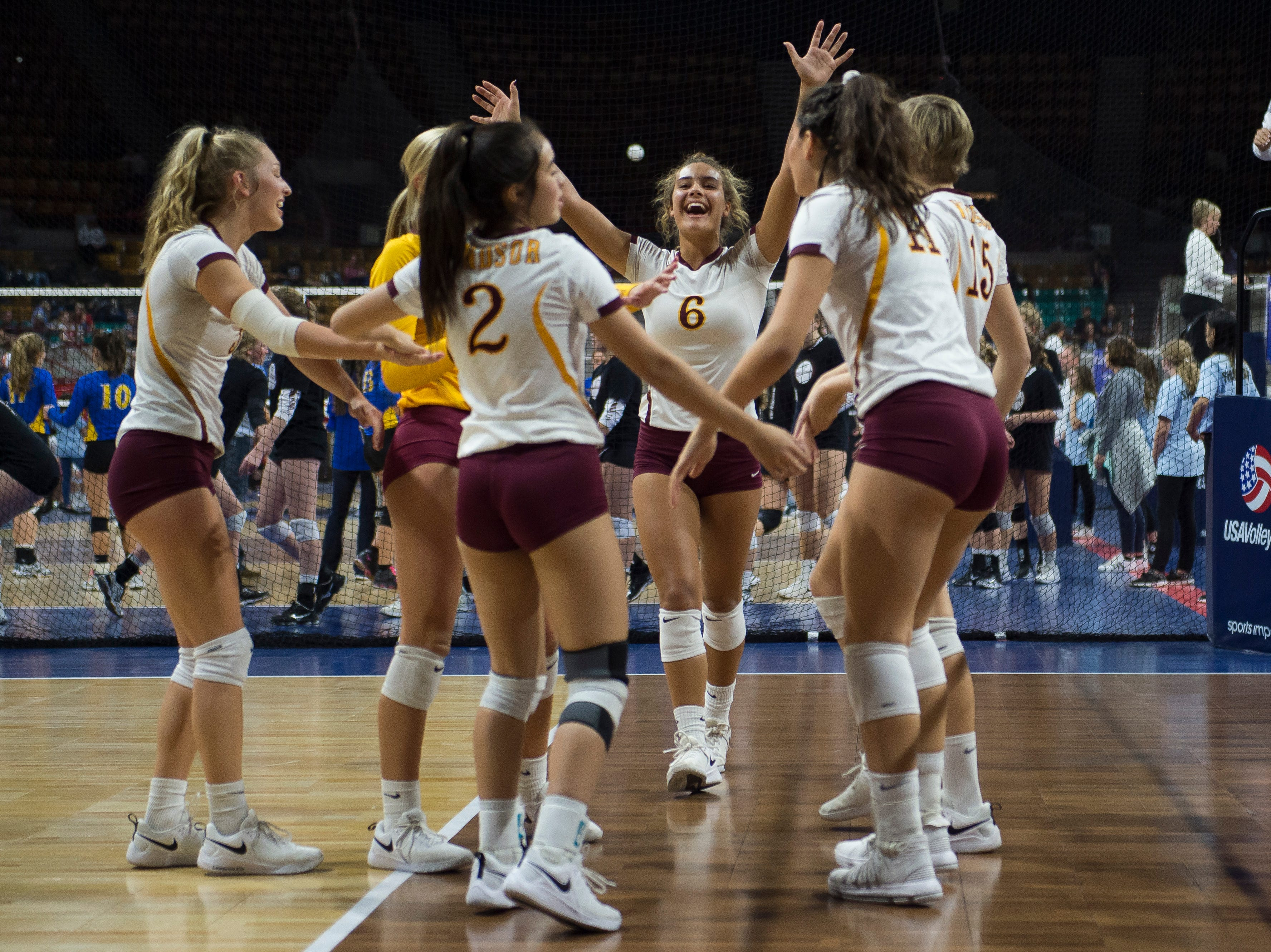 Windsor High School senior Ally Kennis (6) celebrate s appoint with er teammates during a state first round game against Fossil Ridge High School on Thursday, Nov. 8, 2018, at the Denver Coliseum in Denver, Colo.