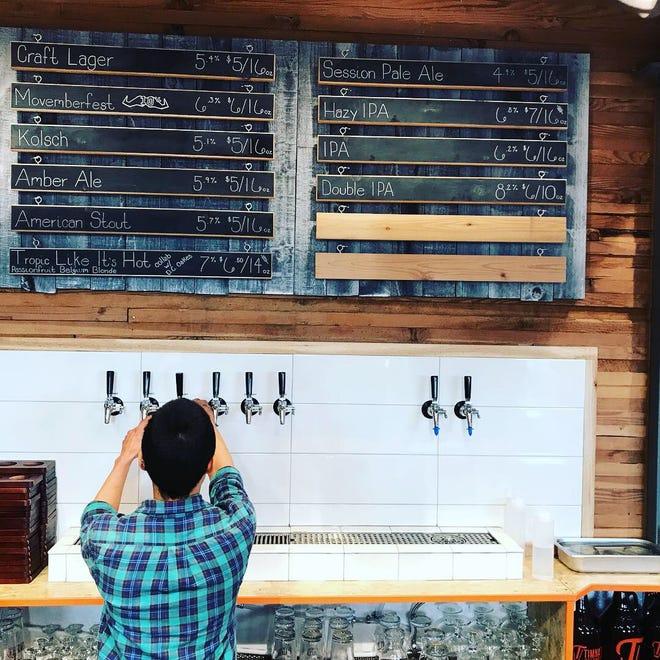 A beertender pours a beer at Timnath Beerwerks.