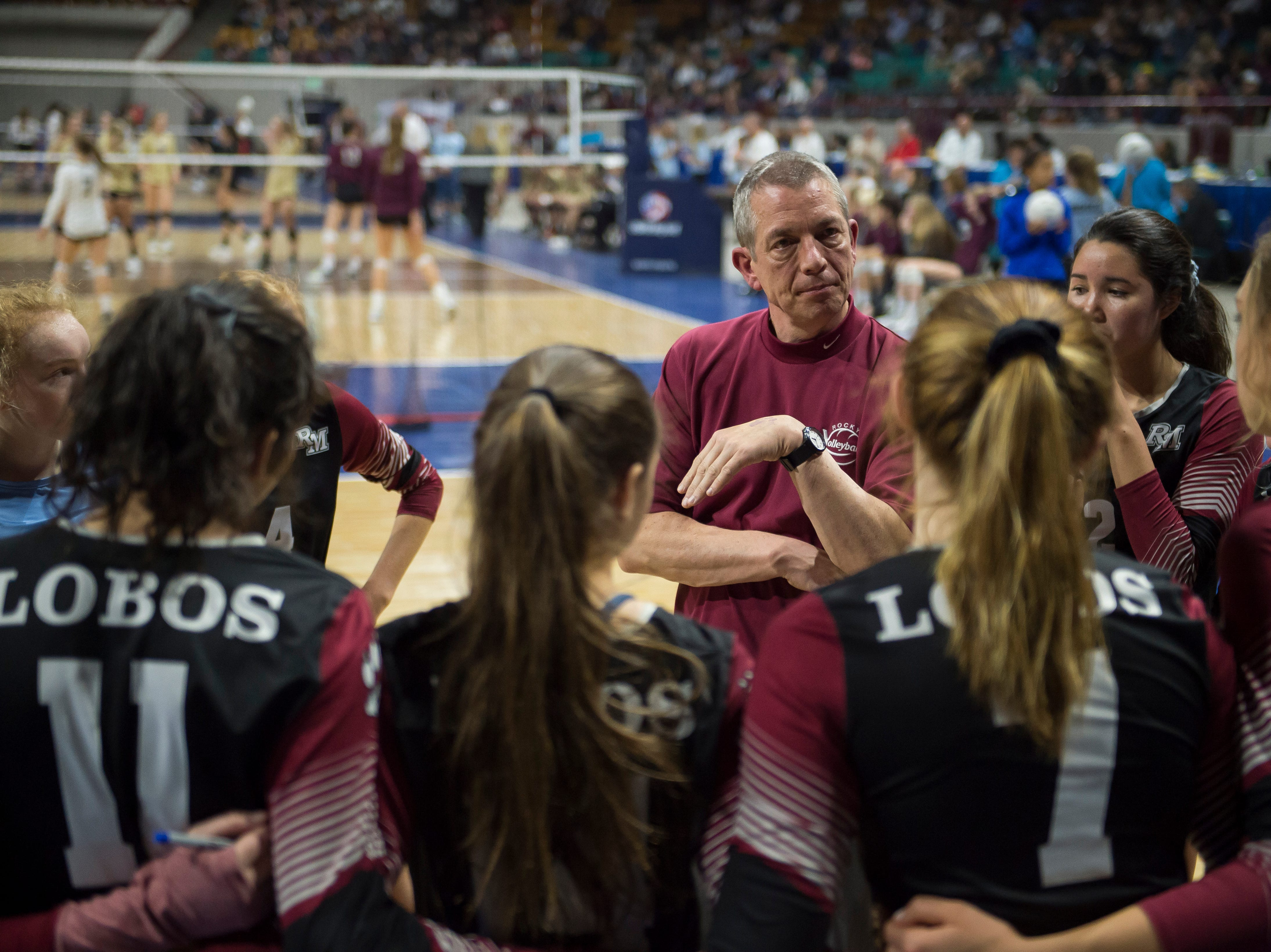 Rocky Mountain High School head coach Glenn Gainley talks with his team during a first round state game against Eaglecrest on Thursday, Nov. 8, 2018, at the Denver Coliseum in Denver, Colo.