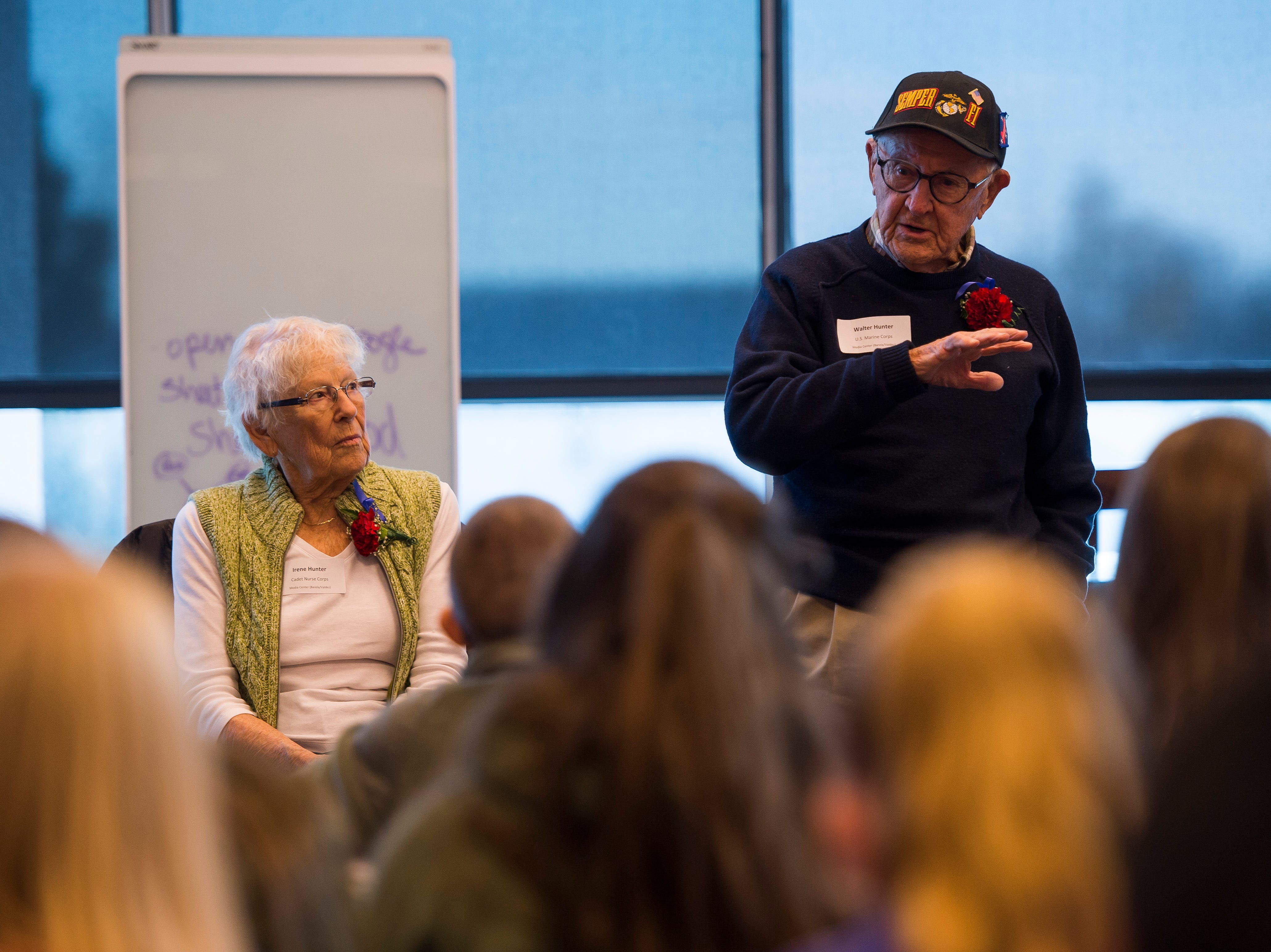 World War II Marine Corp veteran Walter Hunter speaks to a class at Preston Middle School's fourth annual Veterans Day Breakfast while his wife of 72 years and World War II Cadet Nurse Corps veteran Irene Hunter looks on, Friday, Nov. 9, 2018, at Preston Middle School in Fort Collins, Colo.