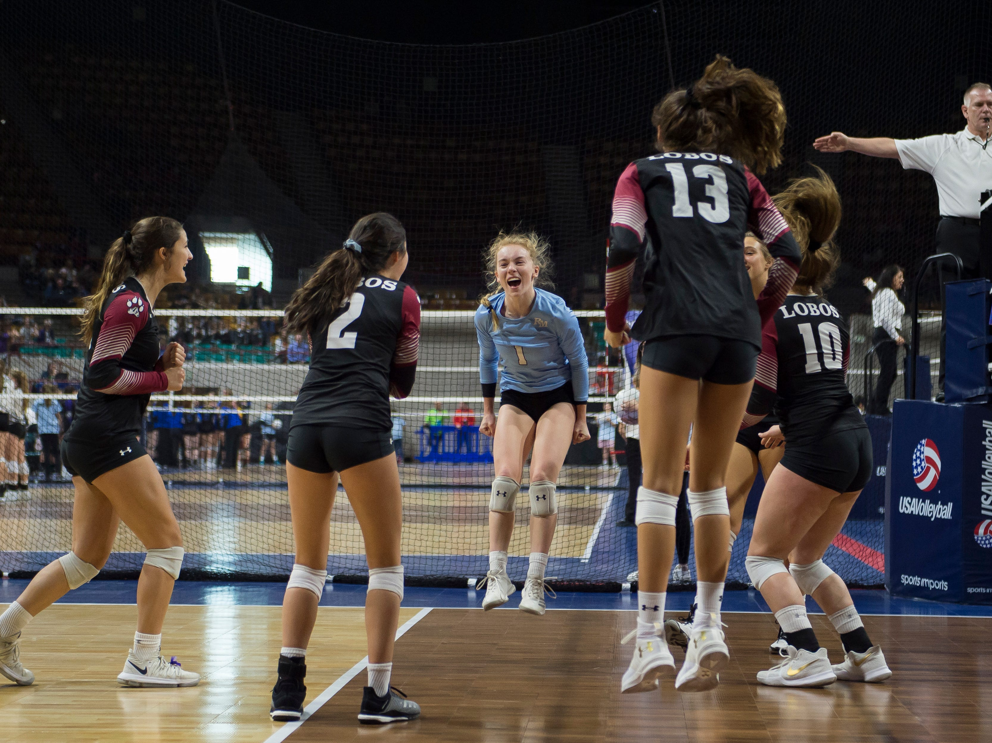 The Rocky Mountain High School volleyball team celebrates a point during a first round state game against Eaglecrest on Thursday, Nov. 8, 2018, at the Denver Coliseum in Denver, Colo.