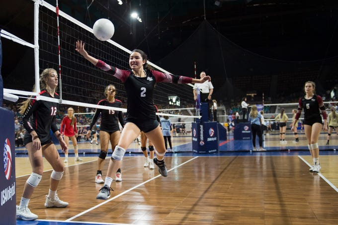 Rocky Mountain High School junior Kiki Mayes saves a volley during a first round state game against Eaglecrest on Thursday, Nov. 8, 2018, at the Denver Coliseum in Denver, Colo.