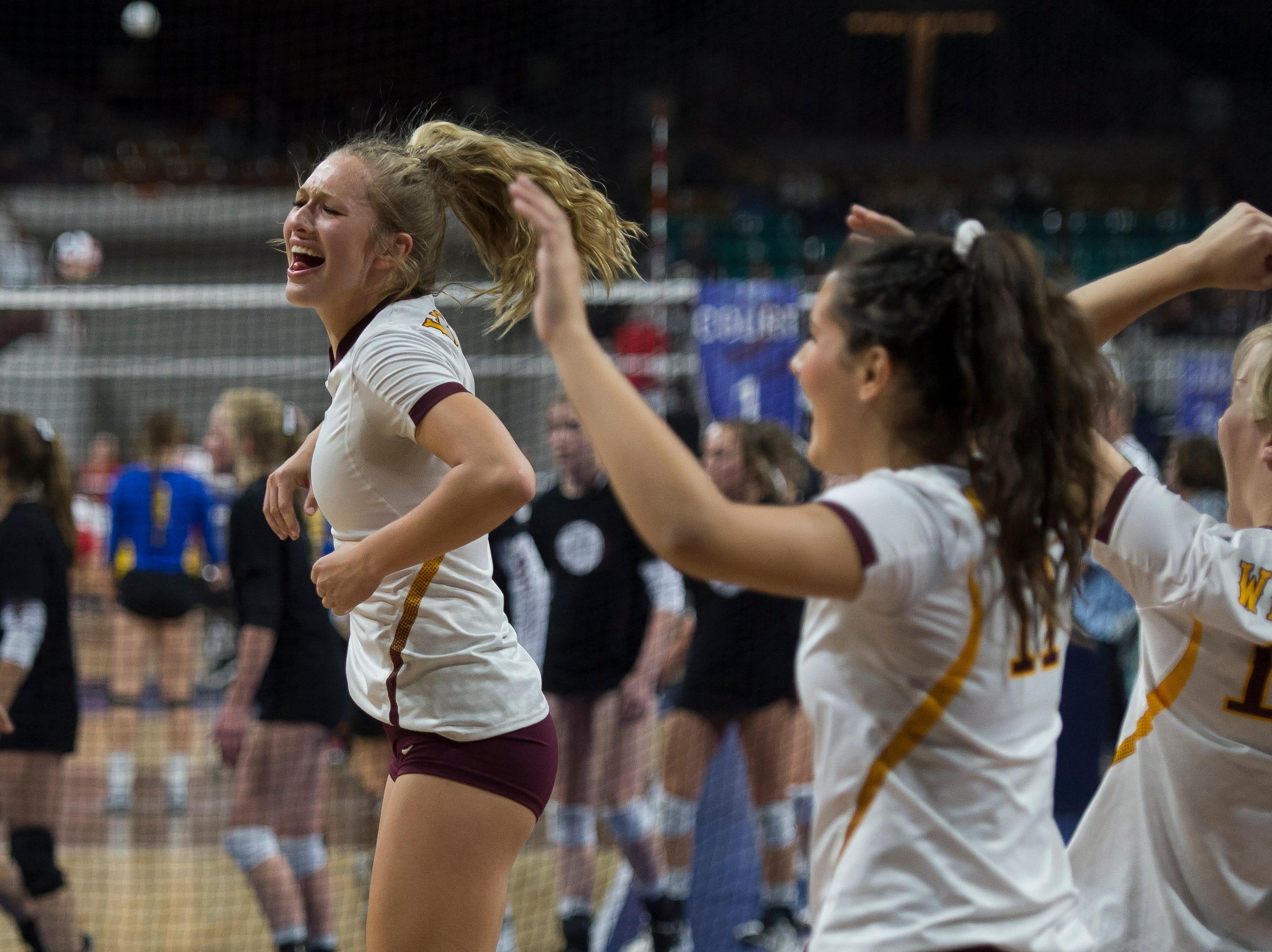 Windsor High School senior Rylee Greiman (5) celebrate a pint with her teammates during a state first round game against Fossil Ridge High School on Thursday, Nov. 8, 2018, at the Denver Coliseum in Denver, Colo.