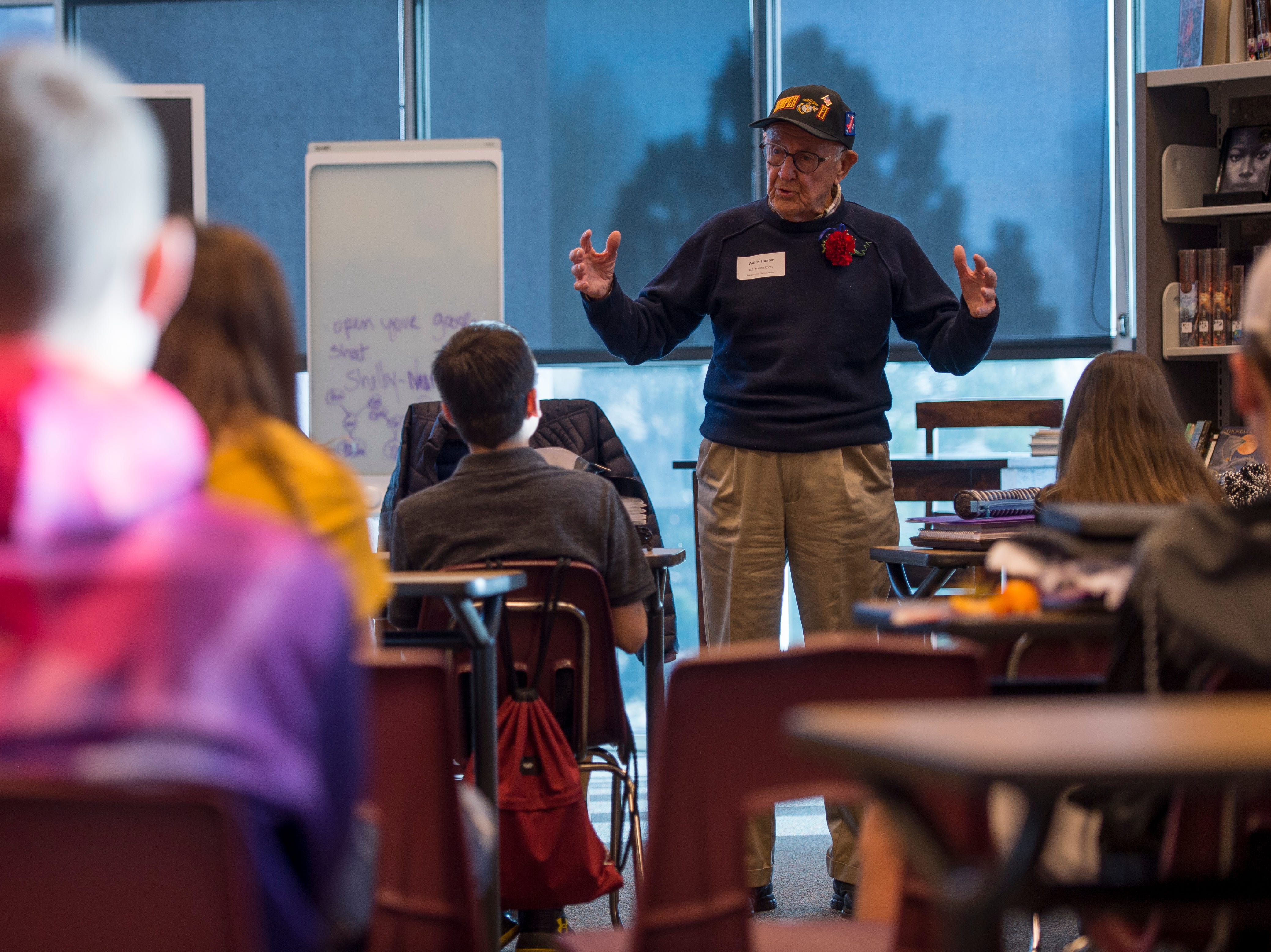 World War II Marine Corp veteran Walter Hunter speaks to a class at Preston Middle School's fourth annual Veterans Day Breakfast on Friday, Nov. 9, 2018, at Preston Middle School in Fort Collins, Colo.