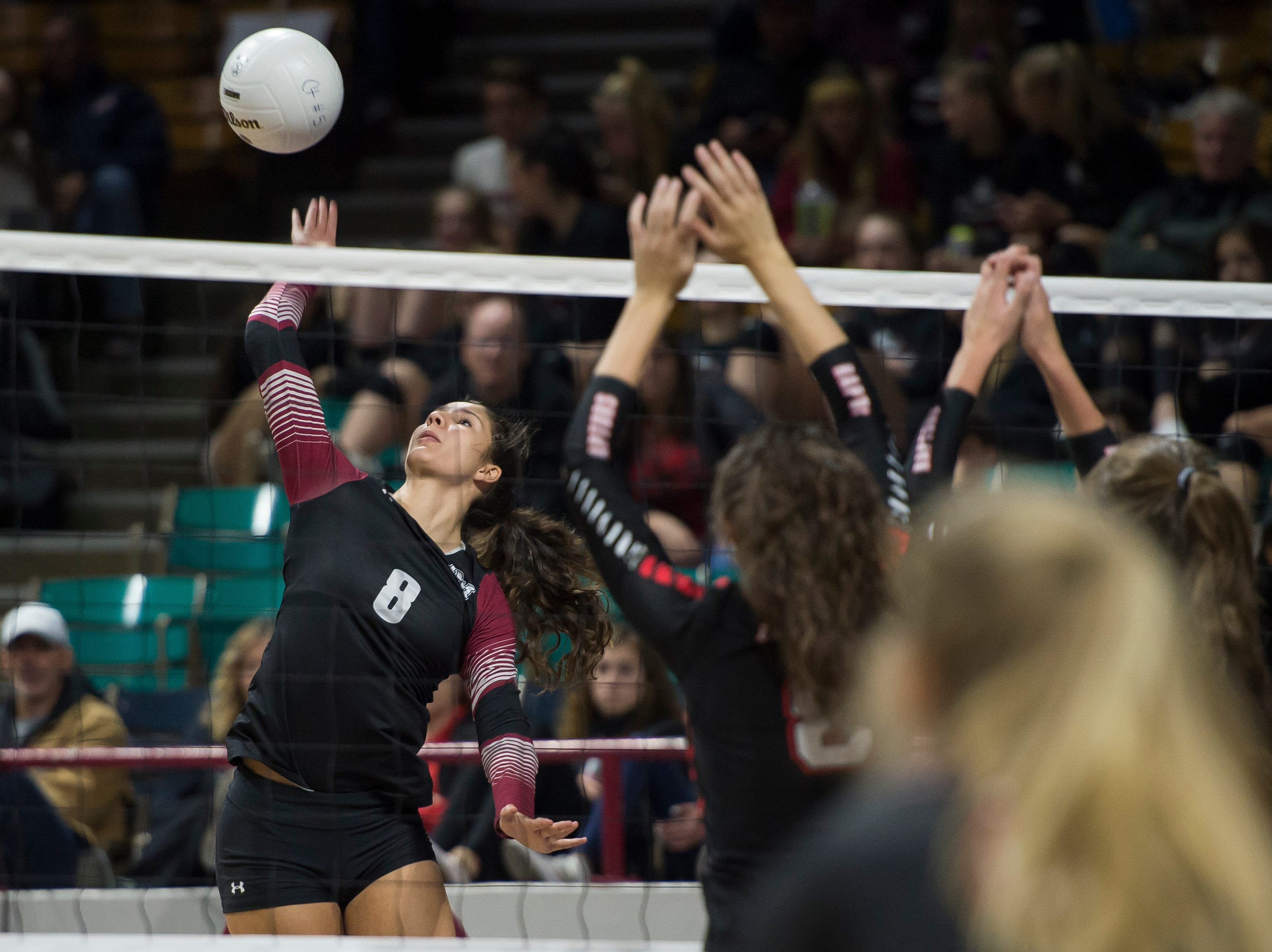 Rocky Mountain High School senior Myles Hilbert (8) looks to spike during a first round state game against Eaglecrest on Thursday, Nov. 8, 2018, at the Denver Coliseum in Denver, Colo.