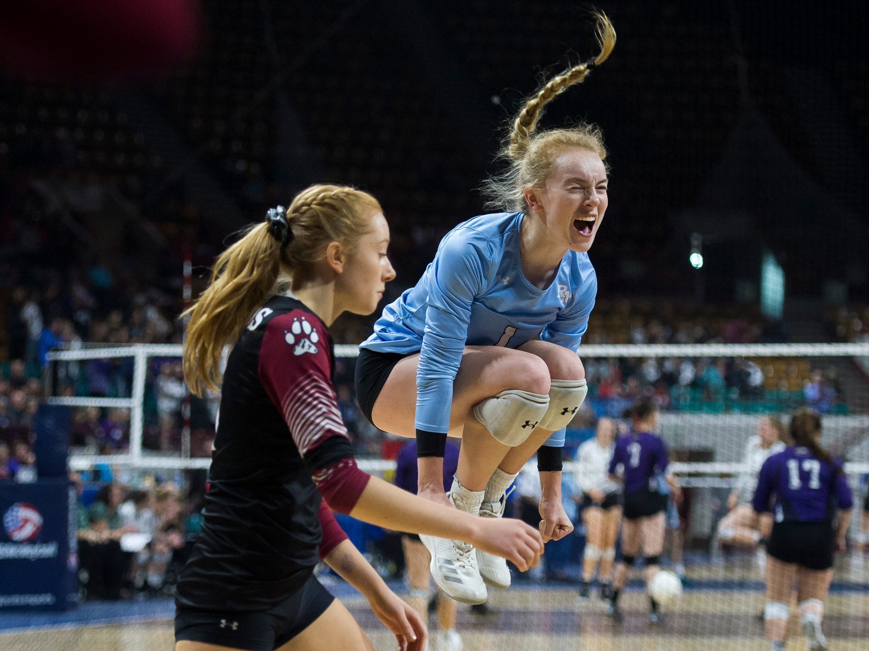 Rocky Mountain High School senior Annika Larson (1) celebrates a point during a first round state game against Eaglecrest on Thursday, Nov. 8, 2018, at the Denver Coliseum in Denver, Colo.