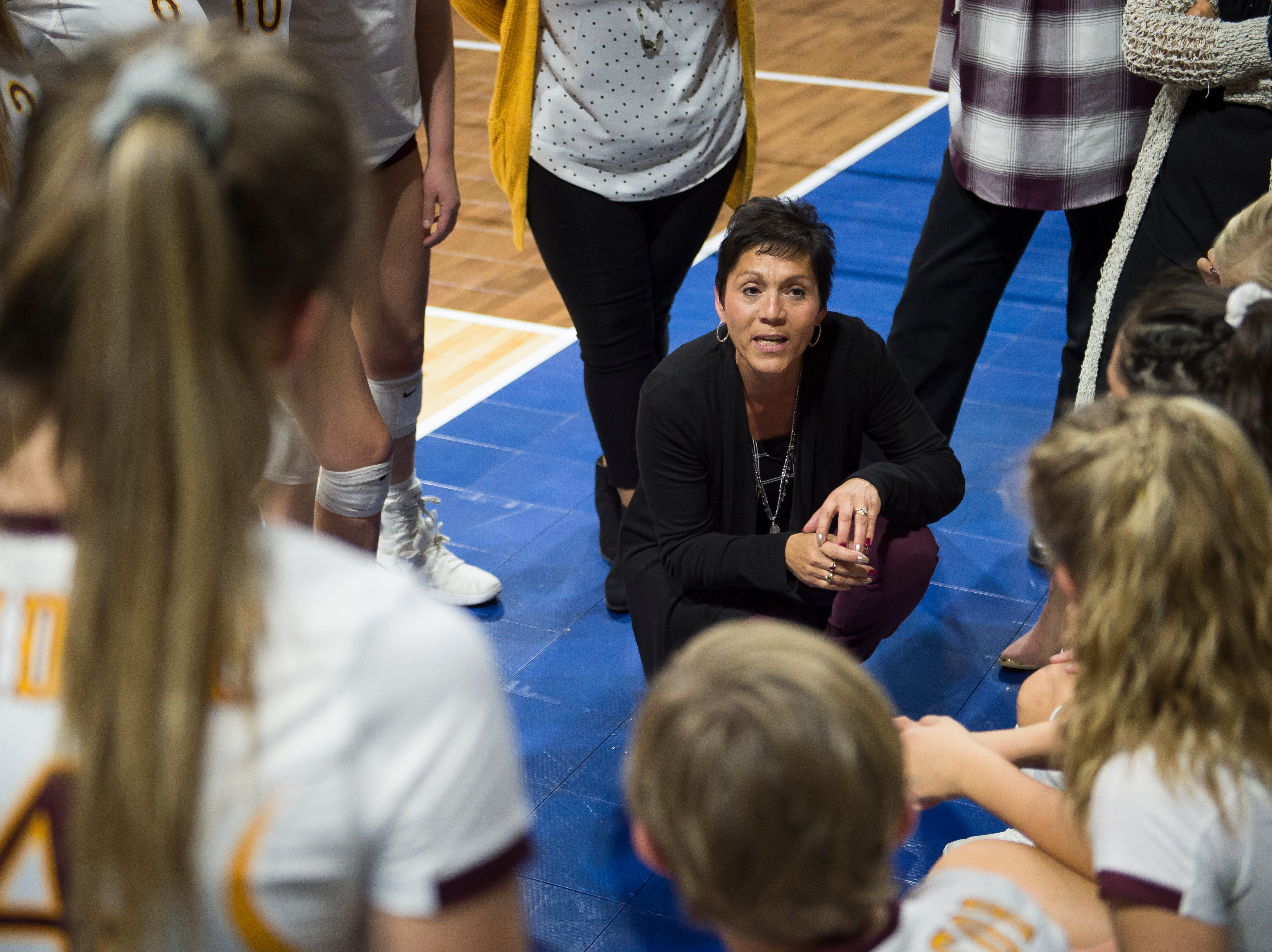 Windsor High School head coach LaVerne Huston talks with her team during a state first round game against Fossil Ridge High School on Thursday, Nov. 8, 2018, at the Denver Coliseum in Denver, Colo.