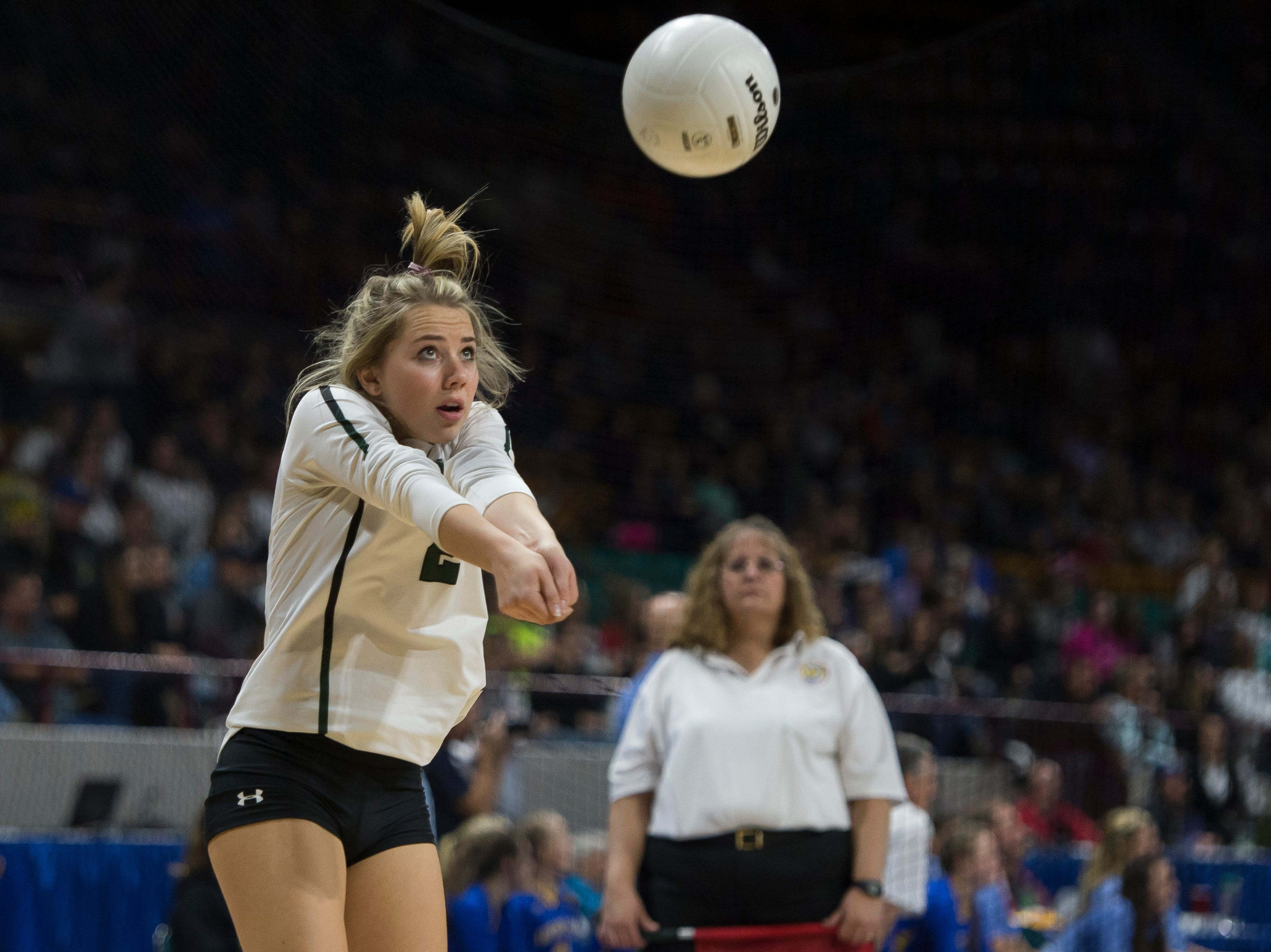 Fossil Ridge High School senior Ellie Brase (2) digs a volley during a state first round game against Windsor High School on Thursday, Nov. 8, 2018, at the Denver Coliseum in Denver, Colo.