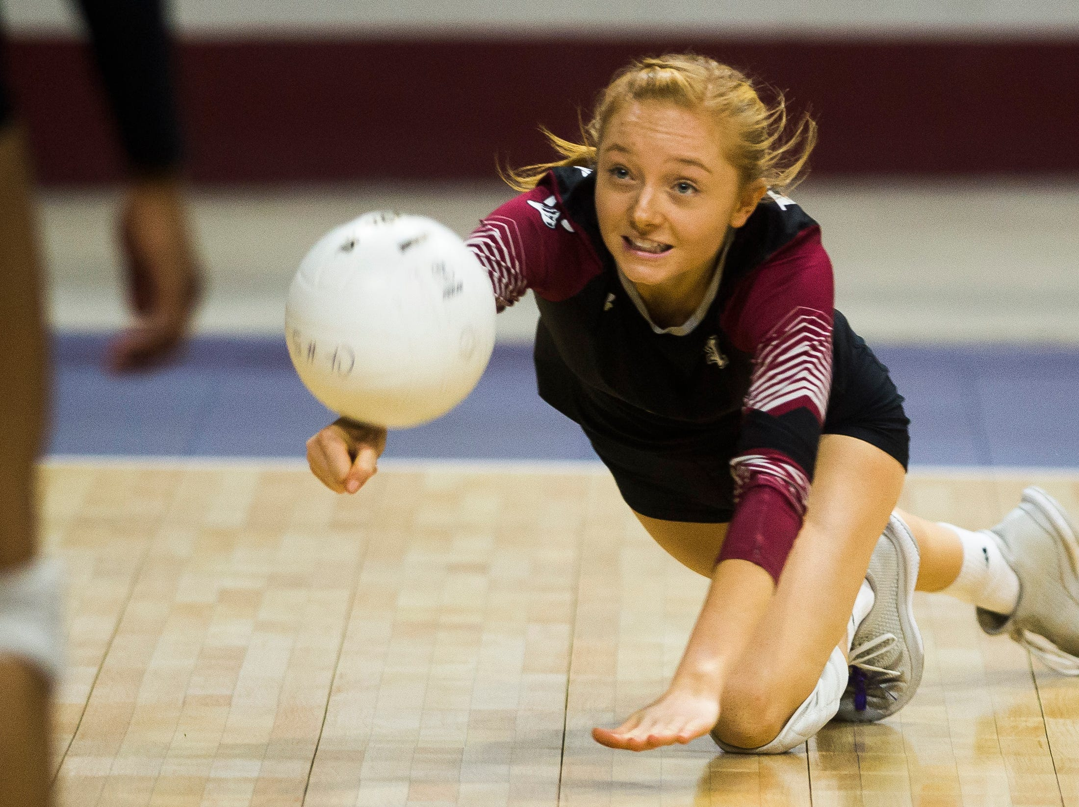 Rocky Mountain High School senior Sydney Swan (4) digs a ball during a first round state game against Eaglecrest on Thursday, Nov. 8, 2018, at the Denver Coliseum in Denver, Colo.