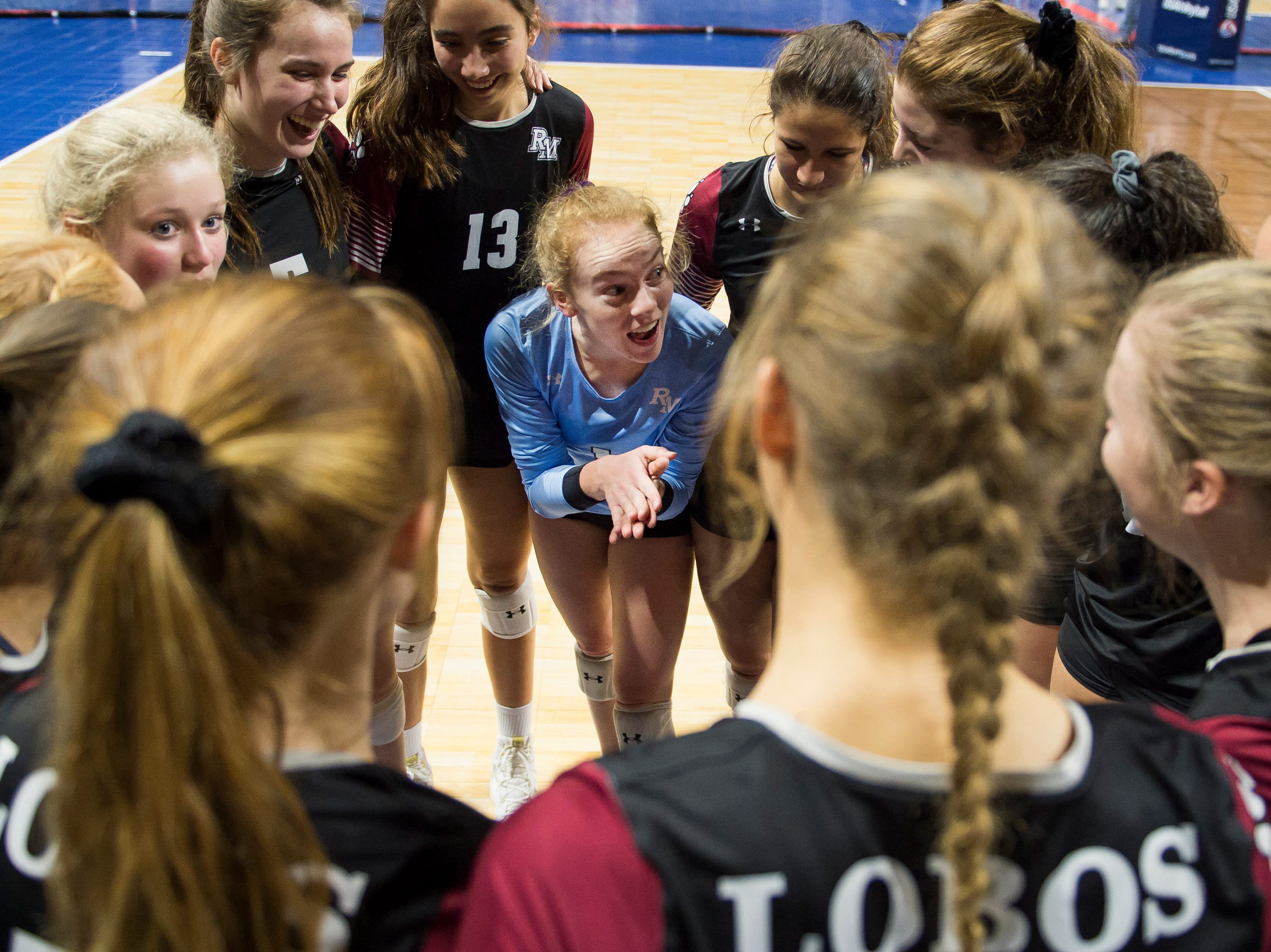 Rocky Mountain High School senior Annika Larson (1) talks her team up just before starting the final set during a first round state game against Eaglecrest on Thursday, Nov. 8, 2018, at the Denver Coliseum in Denver, Colo.
