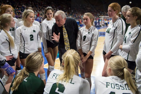 Fossil Ridge High School head coach Paul Shimek talks to his team during a state first round game against Windsor High School on Thursday, Nov. 8, 2018, at the Denver Coliseum in Denver, Colo.