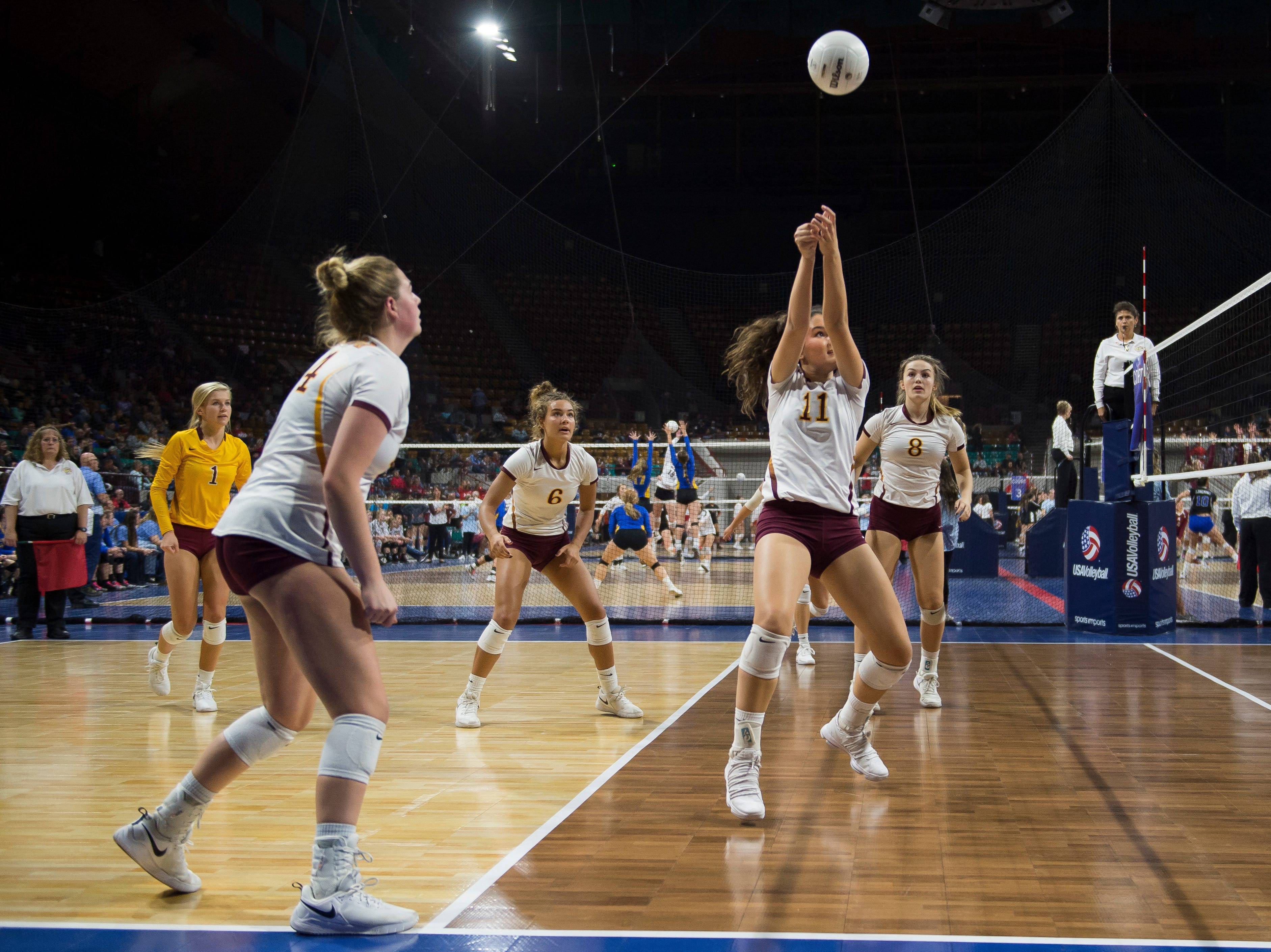 Windsor High School junior Ellie Garrett (11) sets up a teammate during a state first round game against Fossil Ridge High School on Thursday, Nov. 8, 2018, at the Denver Coliseum in Denver, Colo.