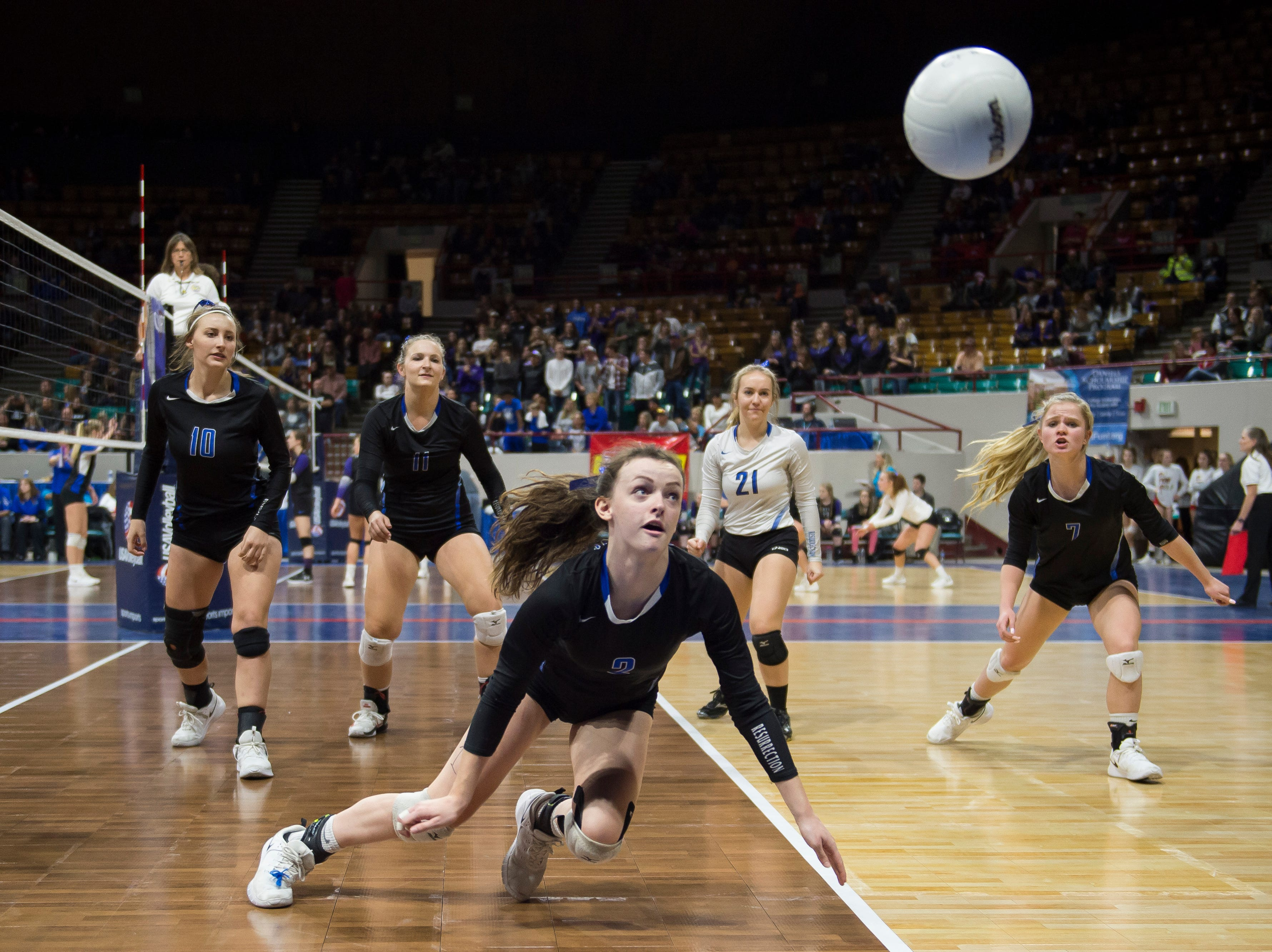 Resurrection Christian freshman Aly Reeser (2) attempts to dig a ball during a first round state game against Faith Christian on Thursday, Nov. 8, 2018, at the Denver Coliseum in Denver, Colo.
