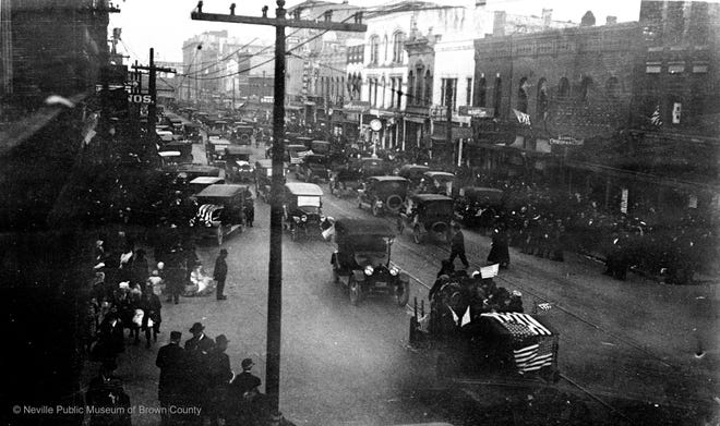 Bells rang and whistles sounded all over Green Bay on Nov. 11, 1918, when World War I ended. Several of the large mills blew their whistles continuously for hours. This photo is of Washington Street, looking north from Cherry Street, in downtown Green Bay.