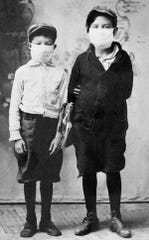 Don Hoover and Joe Sistrunk of Starke, Fla., ready for school during the 1918 Spanish flu epidemic.