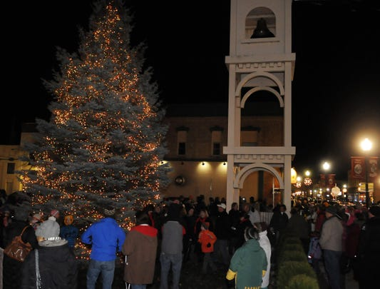 crowds gather for the lighting of the sturgeon bay christmas tree at a previous christmas by