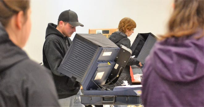 Josh Weigelt casts his ballot electronically at Oconto City Hall in the Nov. 6 election. The flow of voters was steady throughout the day, with the line snaking outside the west door at times.