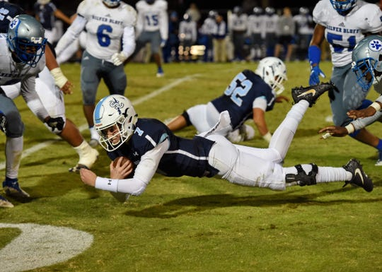 Southside Christian quarterback J.W. Hertzberg stretches out for a first down. Southside Christian hosts Silver Bluff in a round 1 playoff football game Thursday, Nov. 8, 2018.