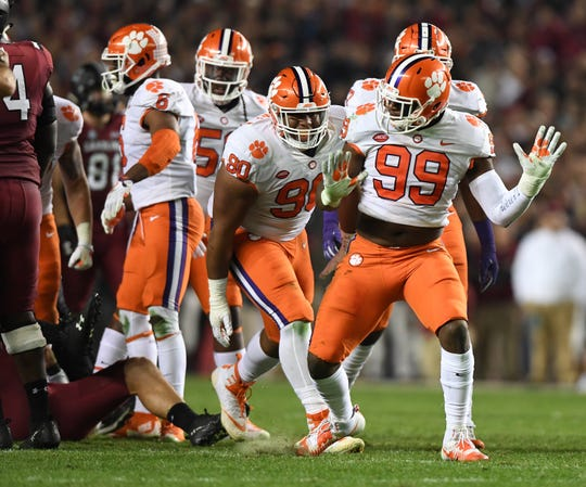 Clemson defensive lineman Clelin Ferrell (99) reacts after sacking South Carolina quarterback Jake Bentley (19) during the 2nd quarter on Saturday, November 25, 2017 at Carolina's Williams Brice Stadium.
