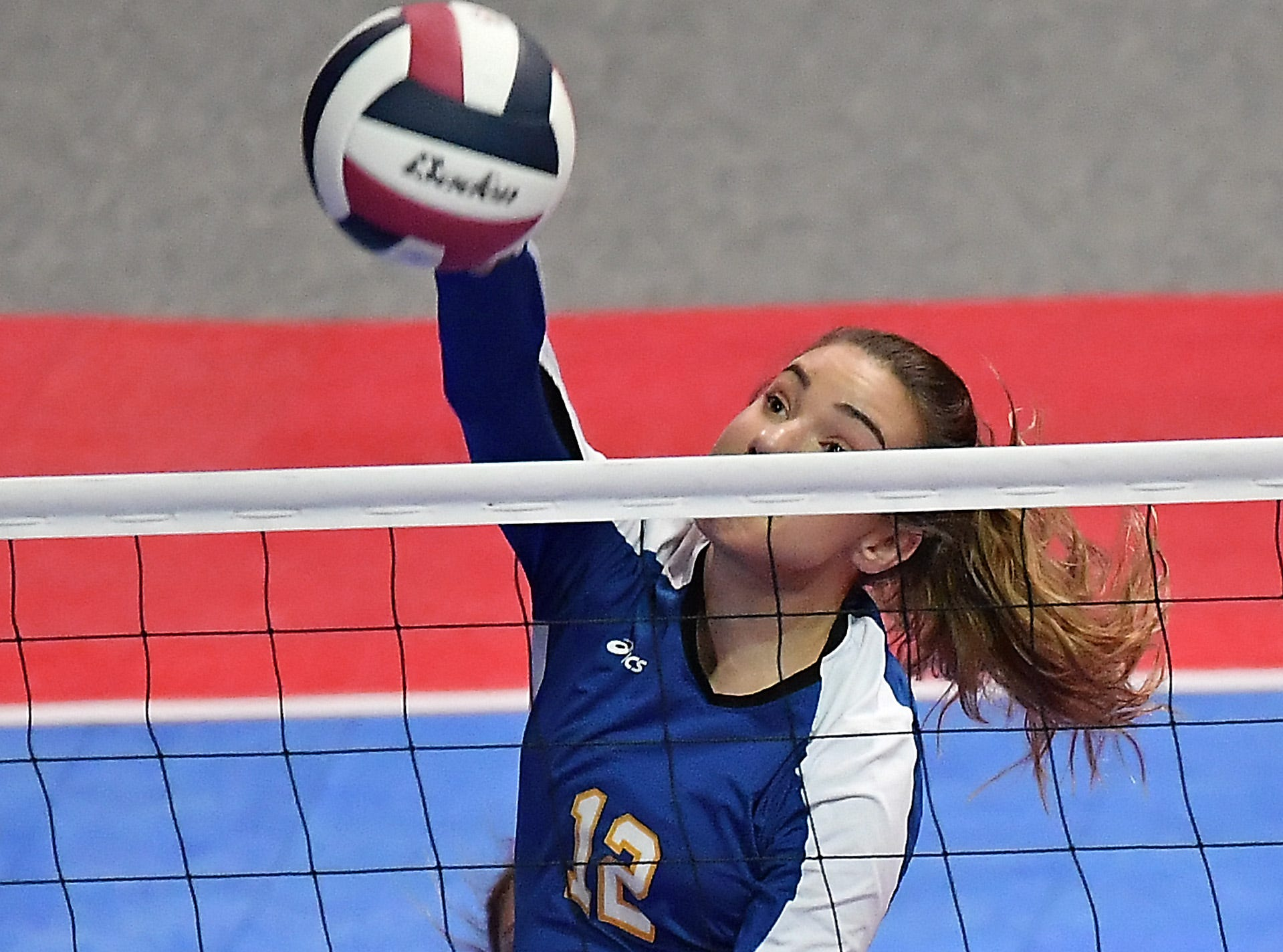 Kylee Cook of Scobey records the kill against Tri-Cities at the All-Class State Volleyball Tournament at the Brick Breeden Fieldhouse in Bozeman Friday.