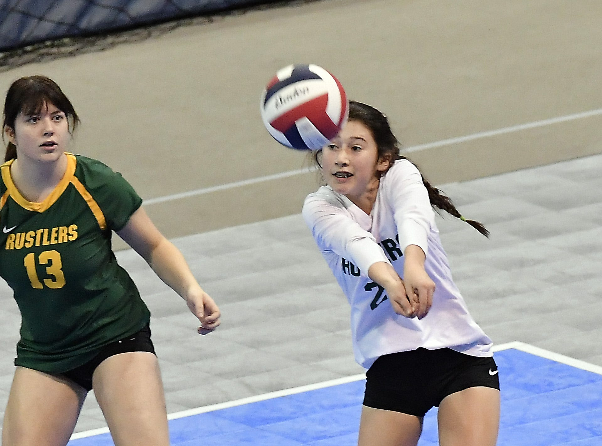 CMR's Lauren Lindseth records the dig as teammate Ally Dube looks on in a match against Kalispell Flathead at the All-Class State Volleyball Tournament at the Brick Breeden Fieldhouse in Bozeman Friday.