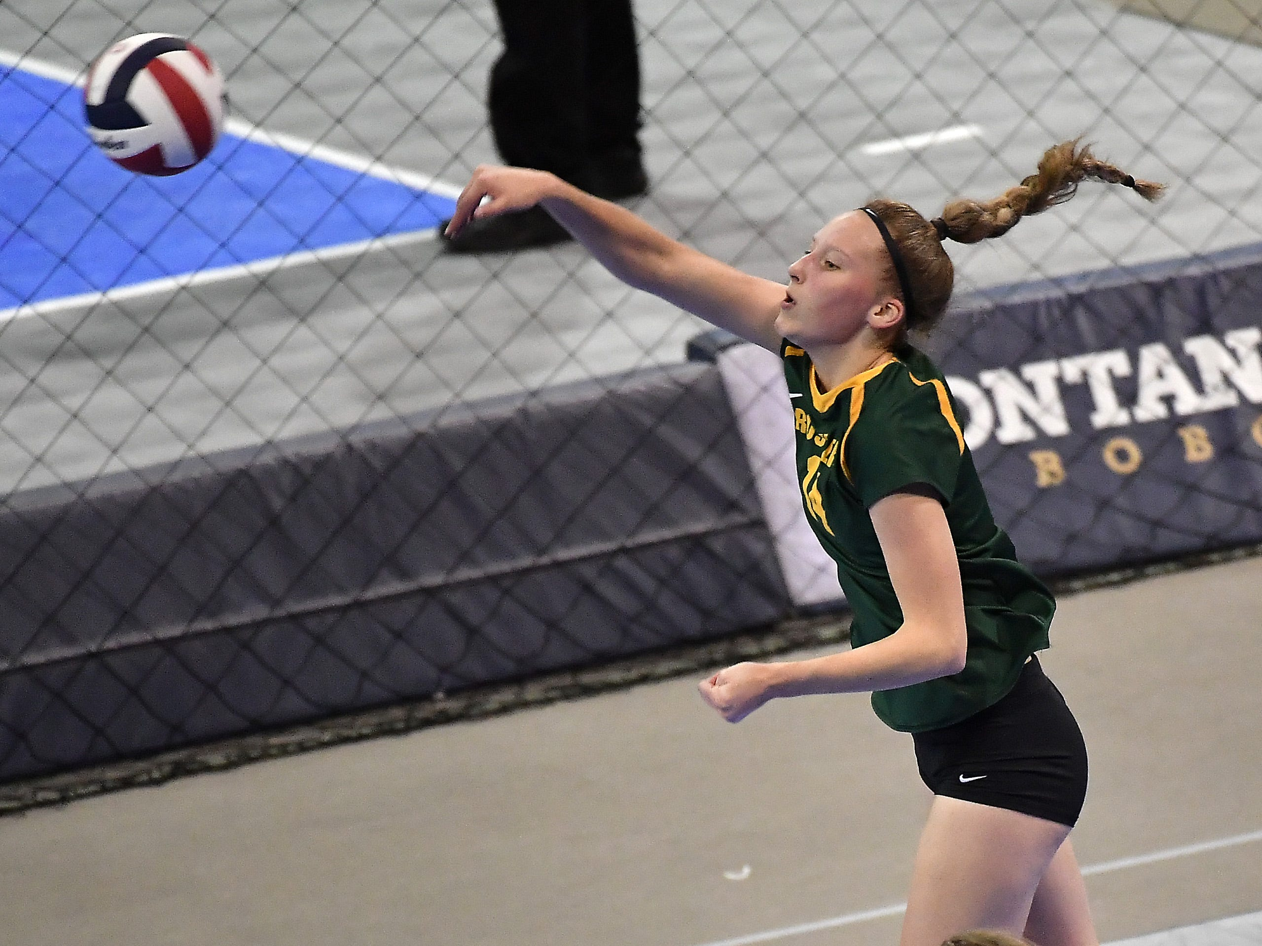 CMR's Allie Olsen records a kill during a match with Kalispell Flathead at the All-Class State Volleyball Tournament at the Brick Breeden Fieldhouse in Bozeman Friday.