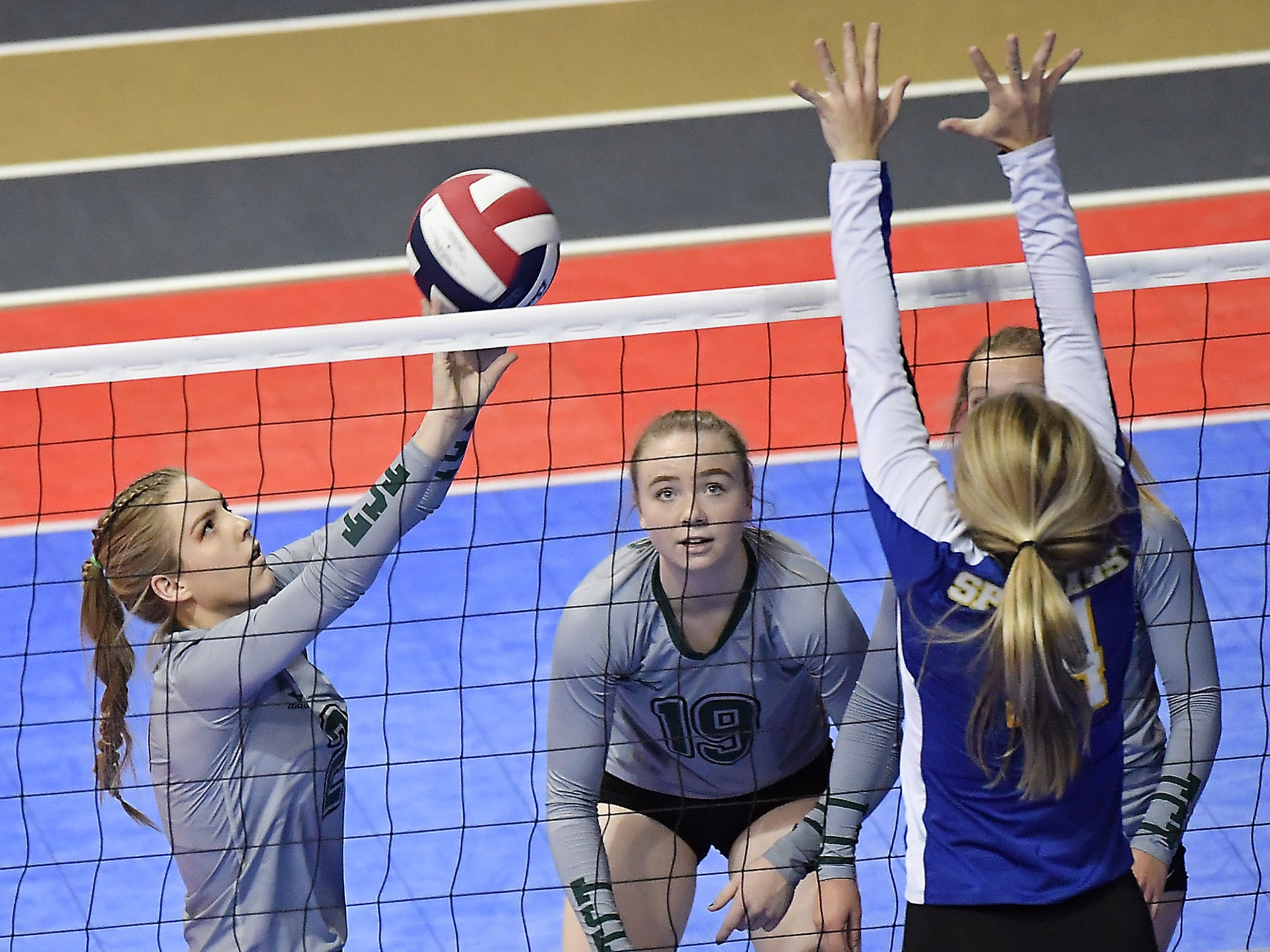 Chloe Derks of Tri-Cities sets during a match with Scobey at the All-Class State Volleyball Tournament at the Brick Breeden Fieldhouse in Bozeman Friday.