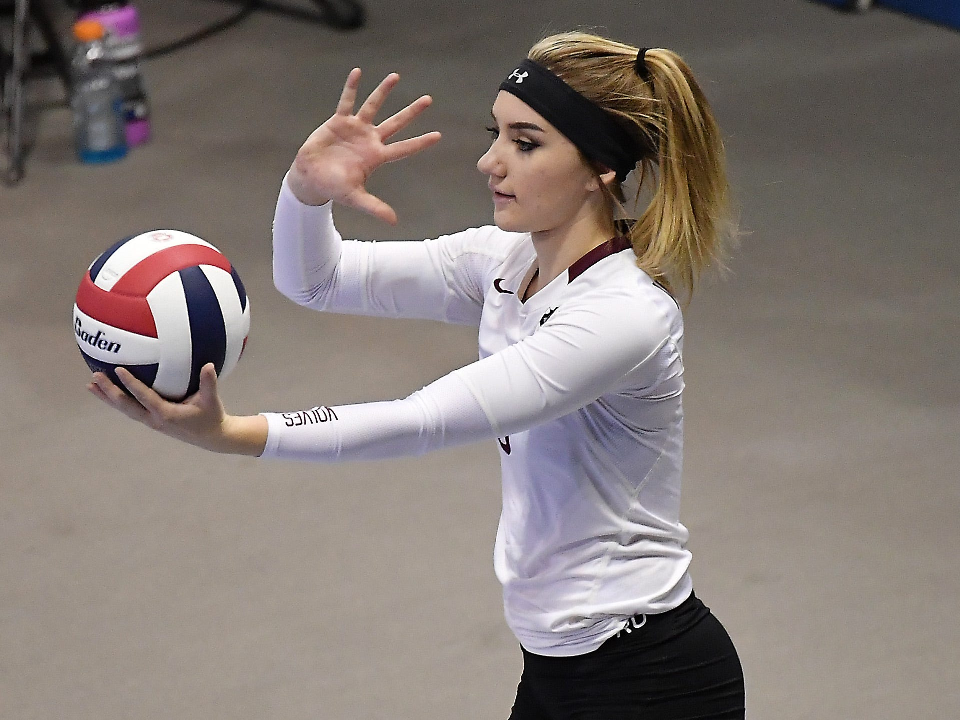 Wolf Point's Paisley Ferdina serves during a match with Deer Lodge at the All-Class State Volleyball Tournament at the Brick Breeden Fieldhouse in Bozeman Friday.