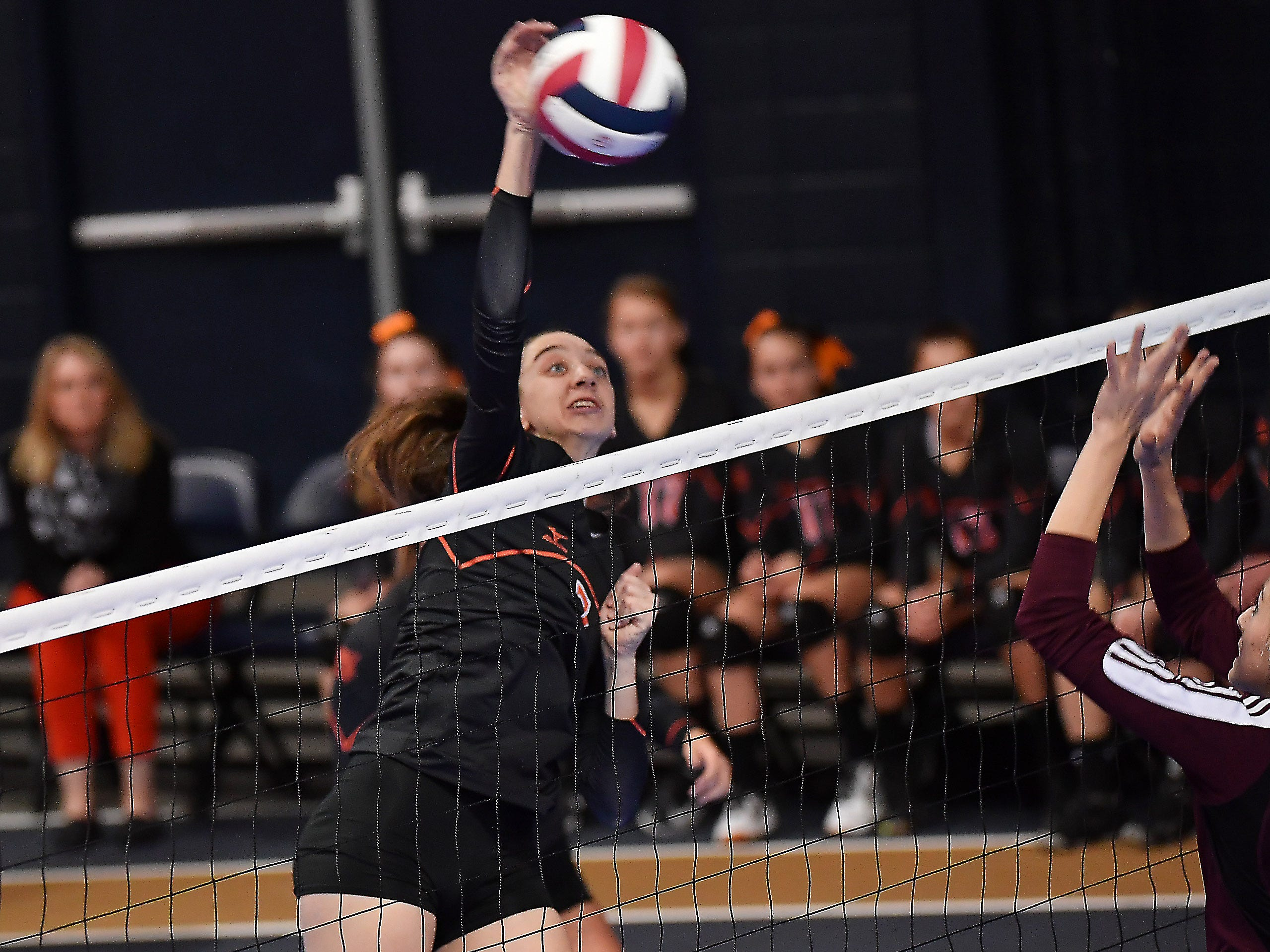 Brenna Osksa of Plentywood spikes the ball against Manhattan Christian at the All-Class State Volleyball Tournament at the Brick Breeden Fieldhouse in Bozeman.
