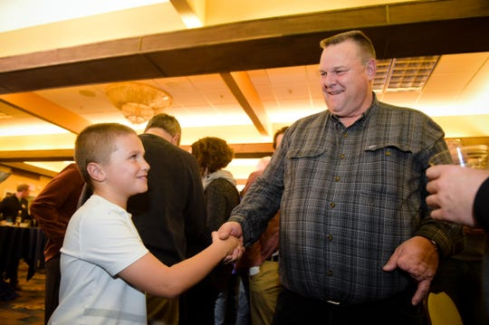 Montana Sen. Jon Tester shakes hands Nov. 6 with Jack Pinski at Tester's election party in Great Falls. (Thom Bridge/Independent Record via AP)