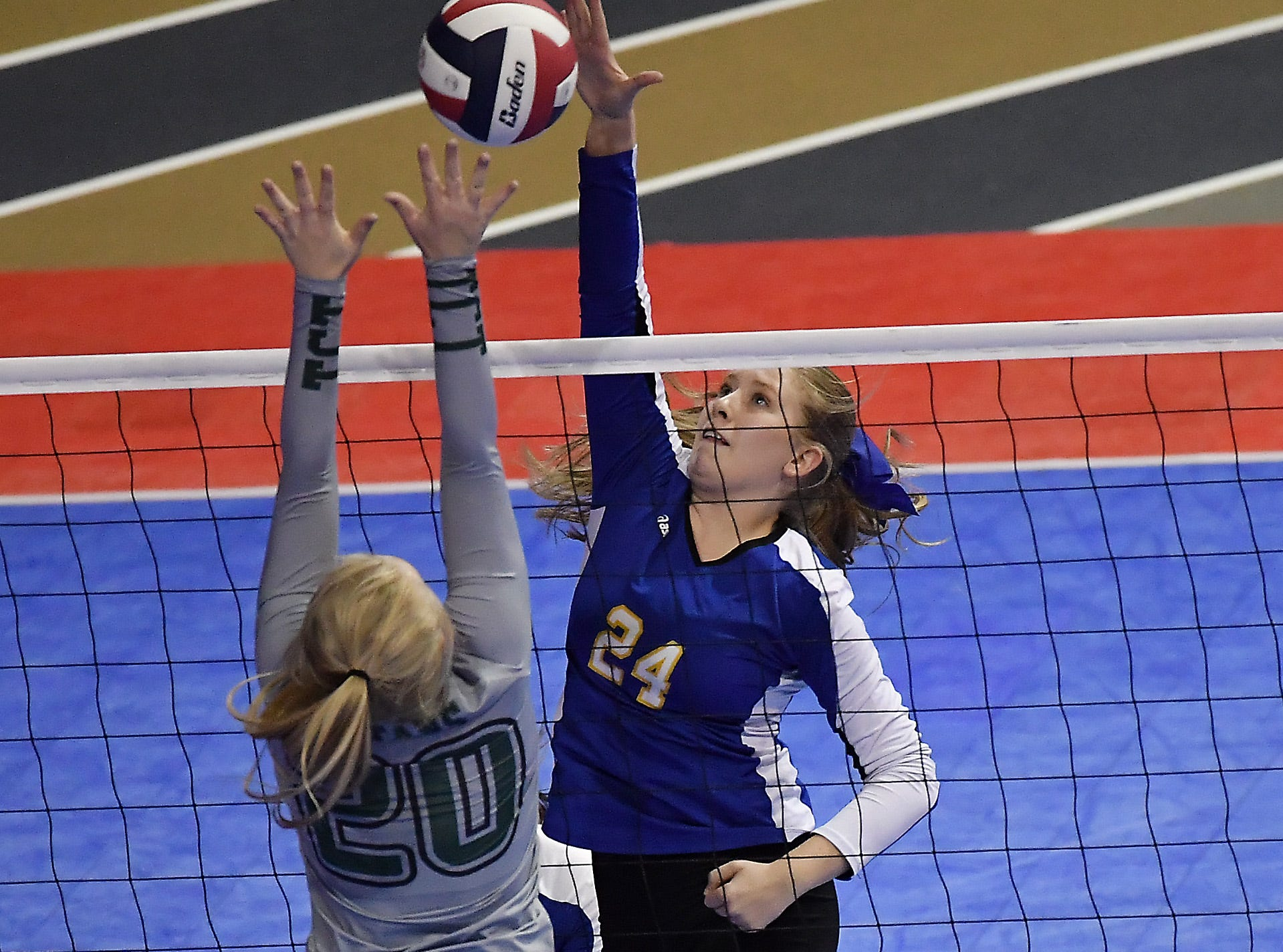 Ryleigh Backman of Scobey tips the ball as Tri-Cities' Sierra Stahl defends the net at the All-Class State Volleyball Tournament at the Brick Breeden Fieldhouse in Bozeman Friday.