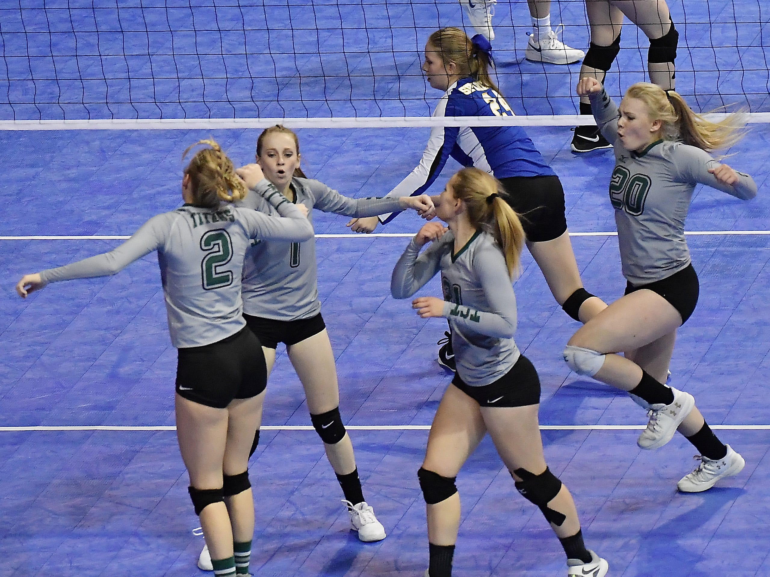 The Tri-Cities Titans celebrate a point during a match with Scobey at the All-Class State Volleyball Tournament at the Brick Breeden Fieldhouse in Bozeman Friday.